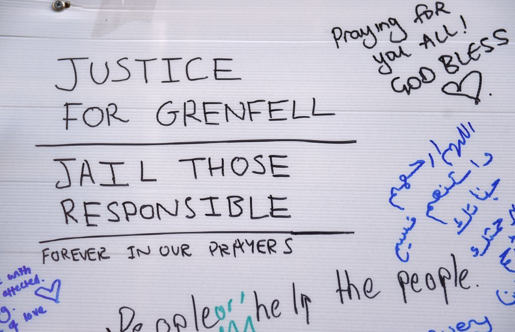 A comment left among tributes close to Grenfell Tower in west London after a fire engulfed the 24-storey building yesterday morning.