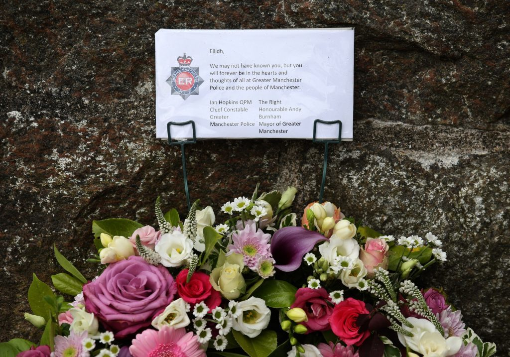 Flowers are laid by an officer from Police Scotland.