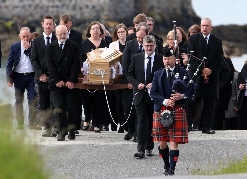 Roddy MacLeod father of Manchester bomb victim Eilidh MacLeod leads the funeral procession.