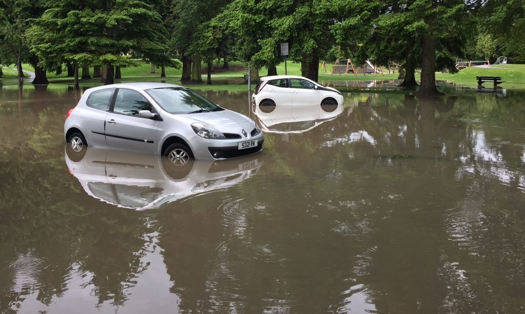 Cars in the deep in the car park of the Bell's sports centre at the North Inch.