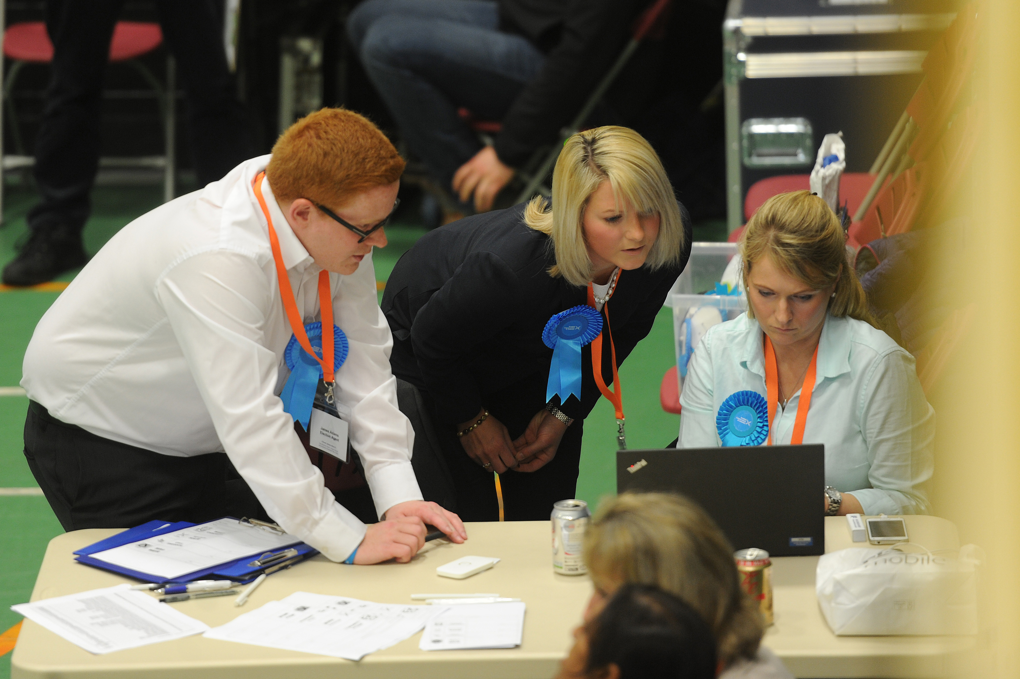 Conservative candidate Kirstene Hair checks the early papers