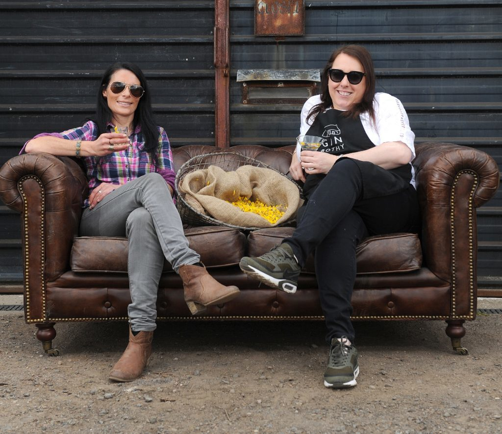 Gayle and Kim enjoy glasses of Gin Collins outside the Gin Bothy HQ.