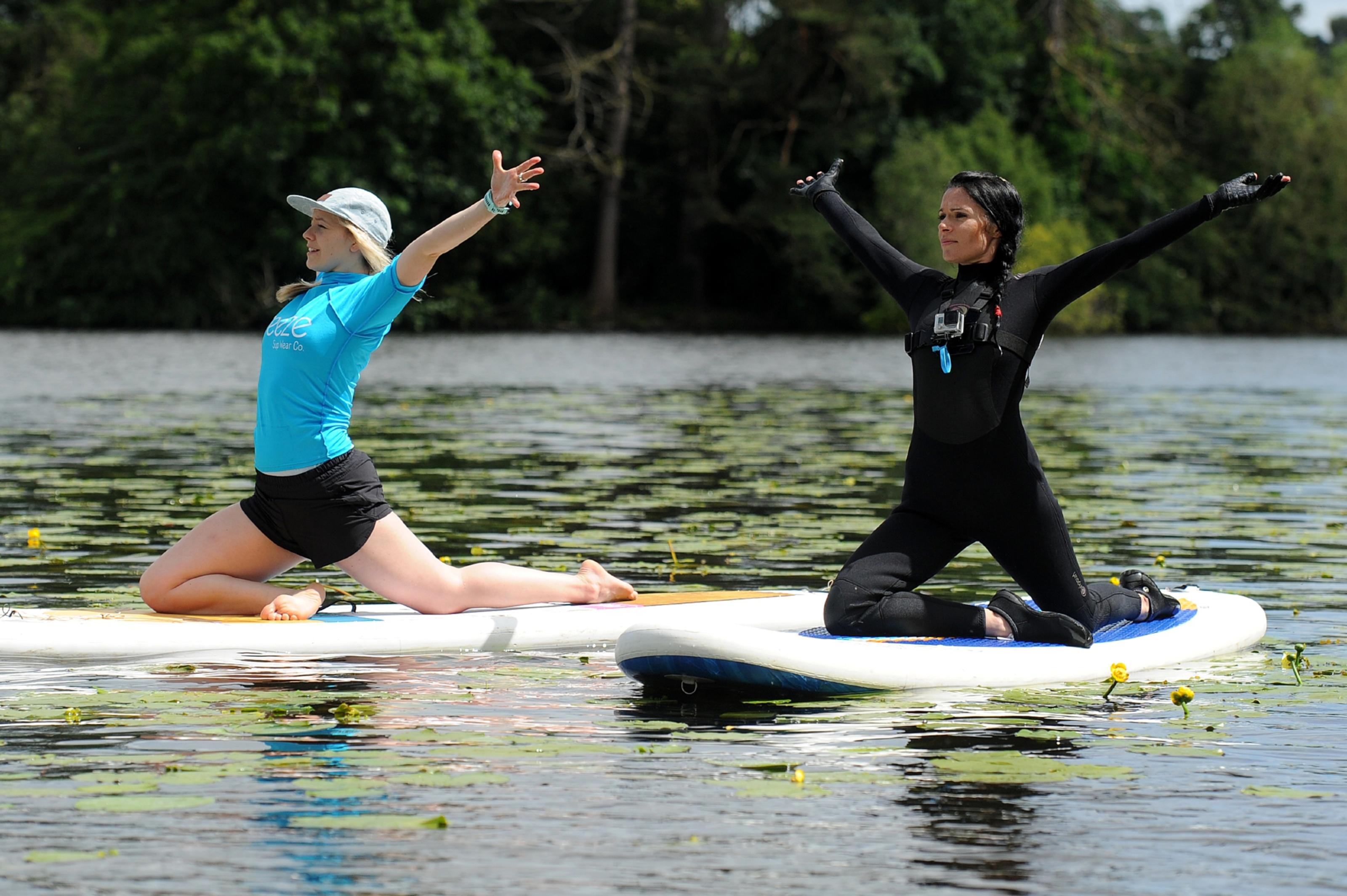 Yoga instructor Michaella Robb and Gayle on Clunie Loch.