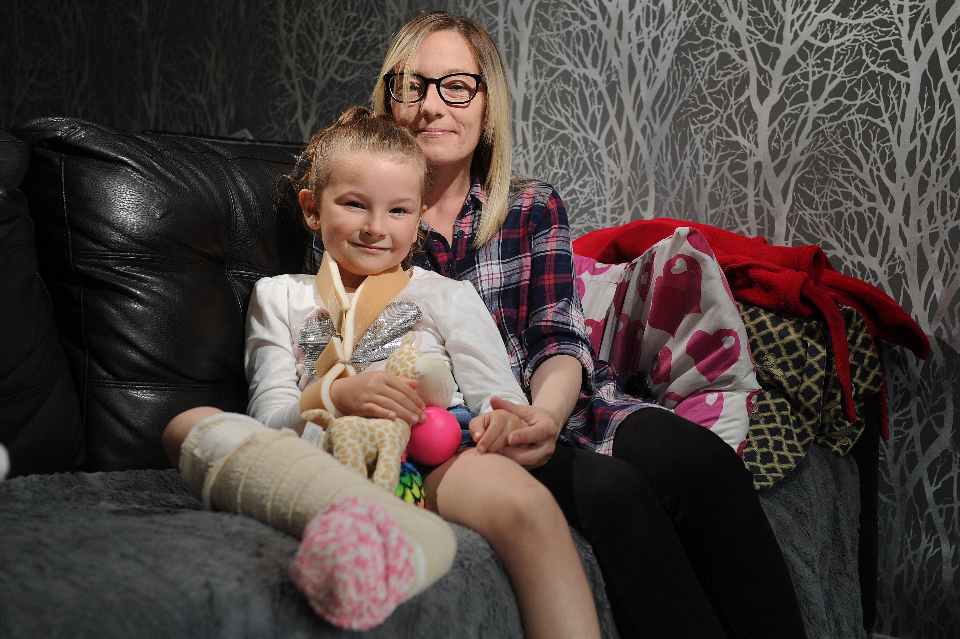 Ava recovering at home with mum Tracy