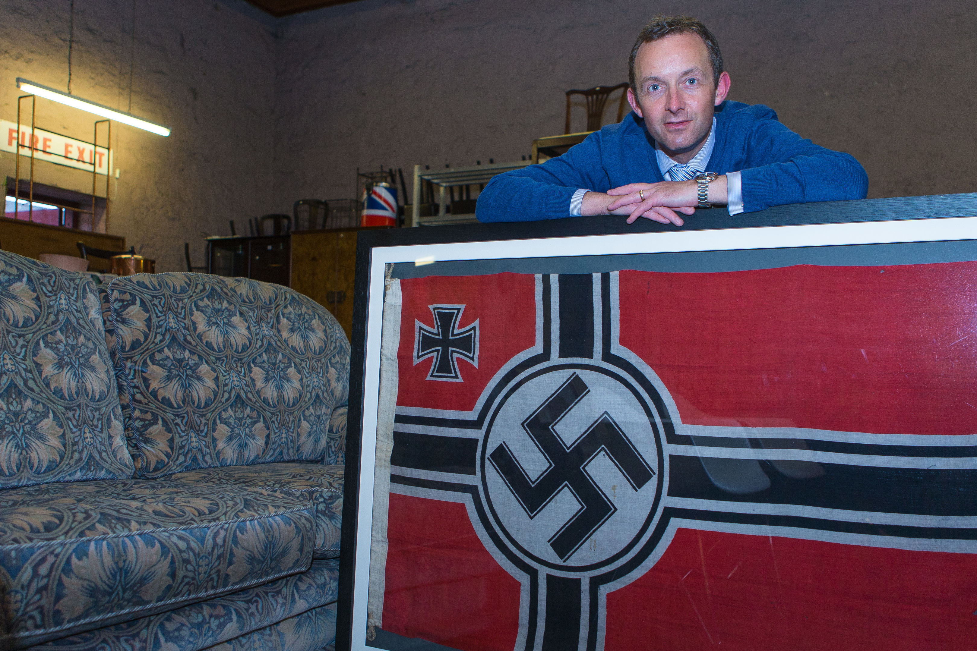 Steven Dewar with the flag from the captured submarine.