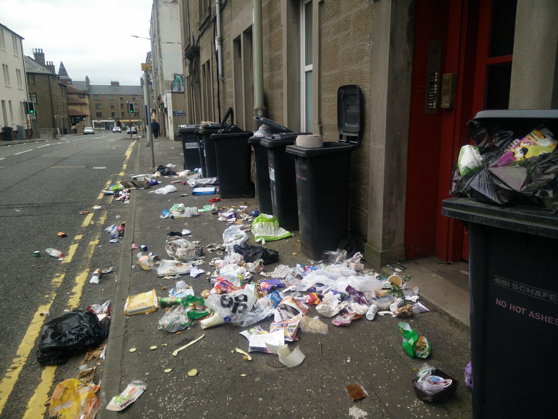The contents of around a dozen bins were emptied onto the pavement