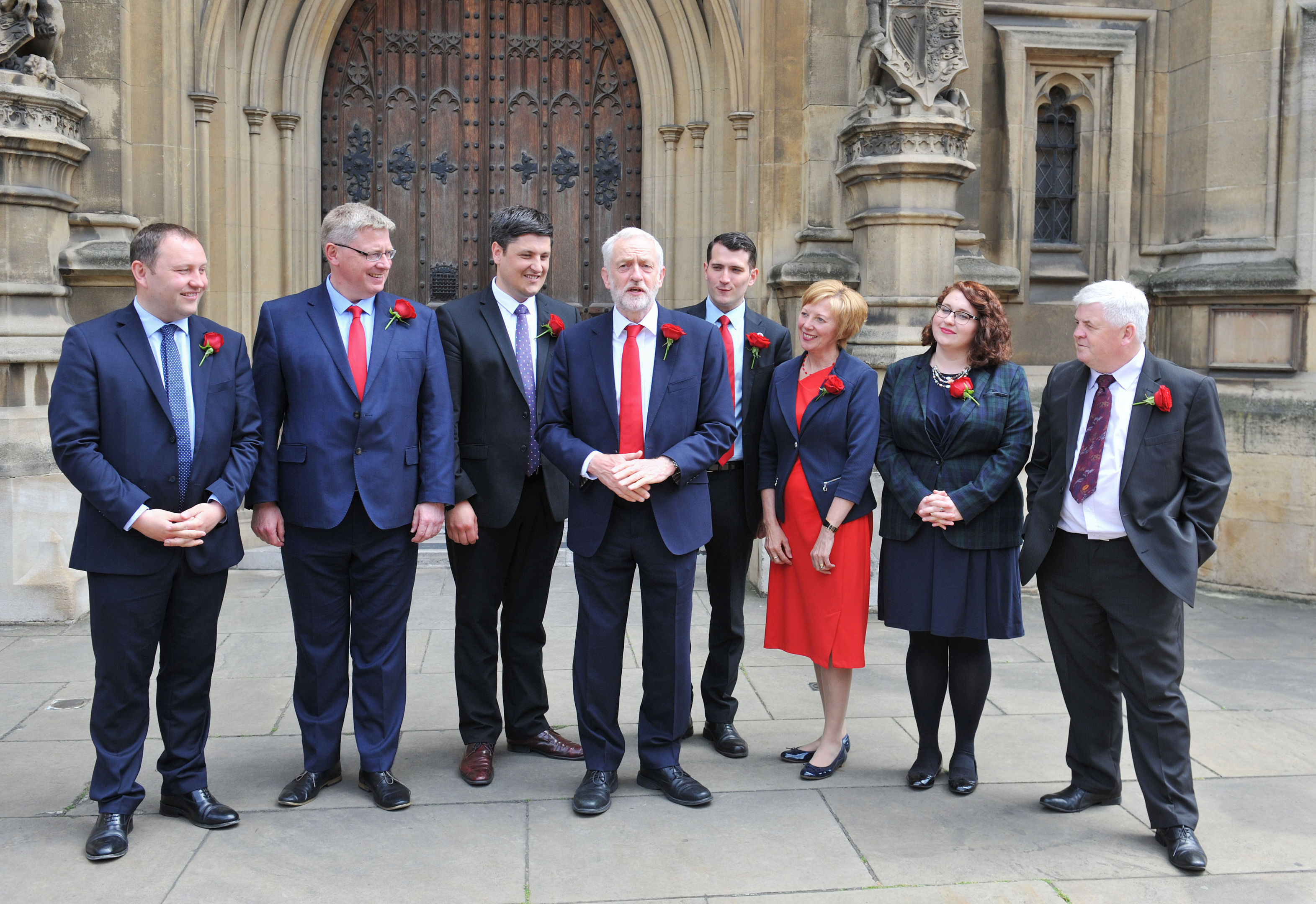 Labour leader Jeremy Corbyn welcomes Scottish Labour MPs outside St Stephen's Entrance to the Houses of Parliament.