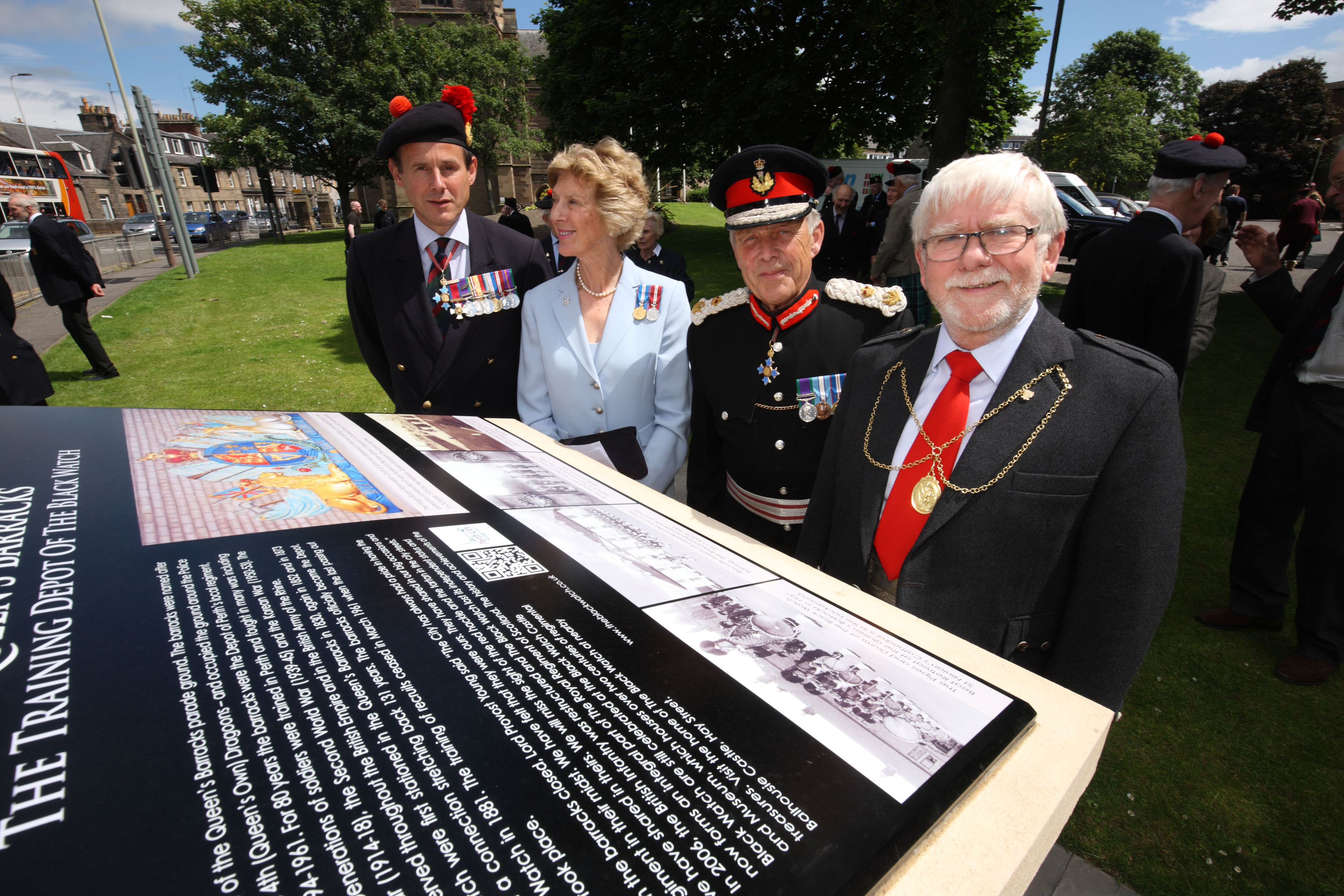 Lieutenant General Cowan, Georgiana Osborne, Lord Lieutenant of Angus, Brigadier Mel Jamieson, Lord Lieutenant of Perthshire  and Perth Provost Dennis Melloy look at the new  plaque commemorating the Queen's Barracks.