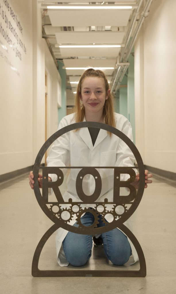 Grace Finlay, Primary Engineer invention winner, with part of her Roll Over Bench invention, which University of Strathclyde's Engineering students are helping to build