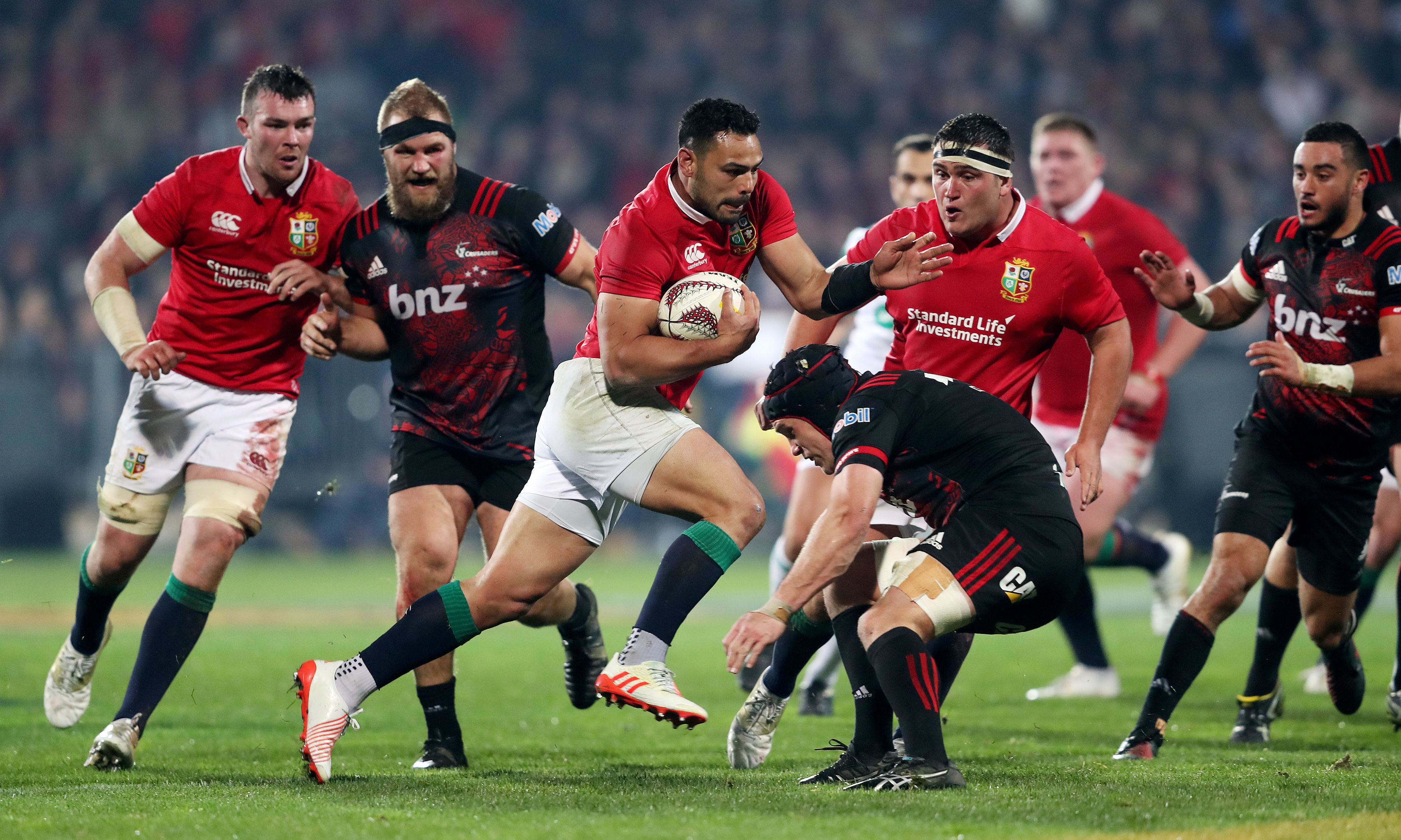 Ben Te'o of the Lions carries hard in the win over the Crusaders in Christchurch.
