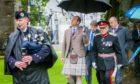 Prince Edward  alongside Lord Lieutenant Brigadier Mel Jameson in Dunkeld.