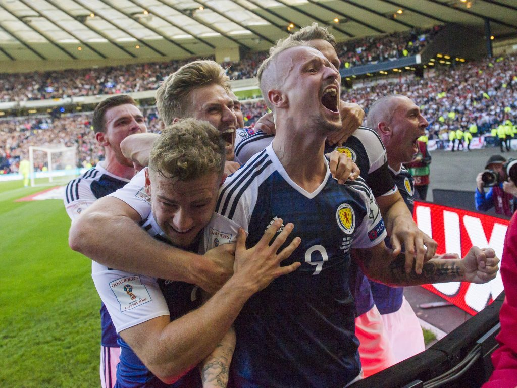 Scotland's players celebrate a Leigh Griffiths' goal.