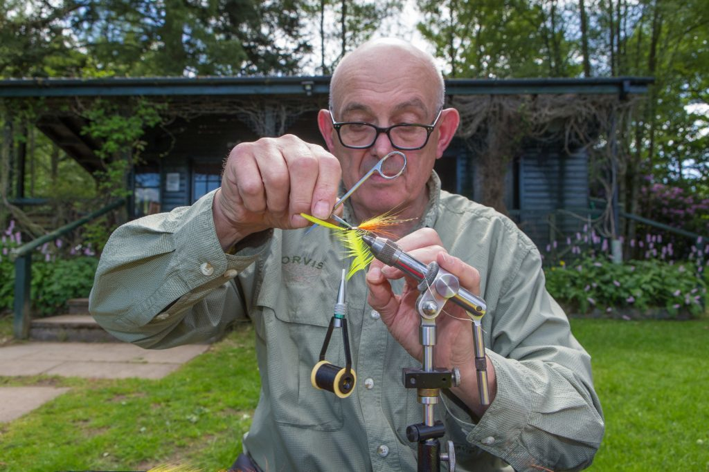 Alberto Laidlaw ties a colourful fly on the banks of the River Tay on the Murthly beat.