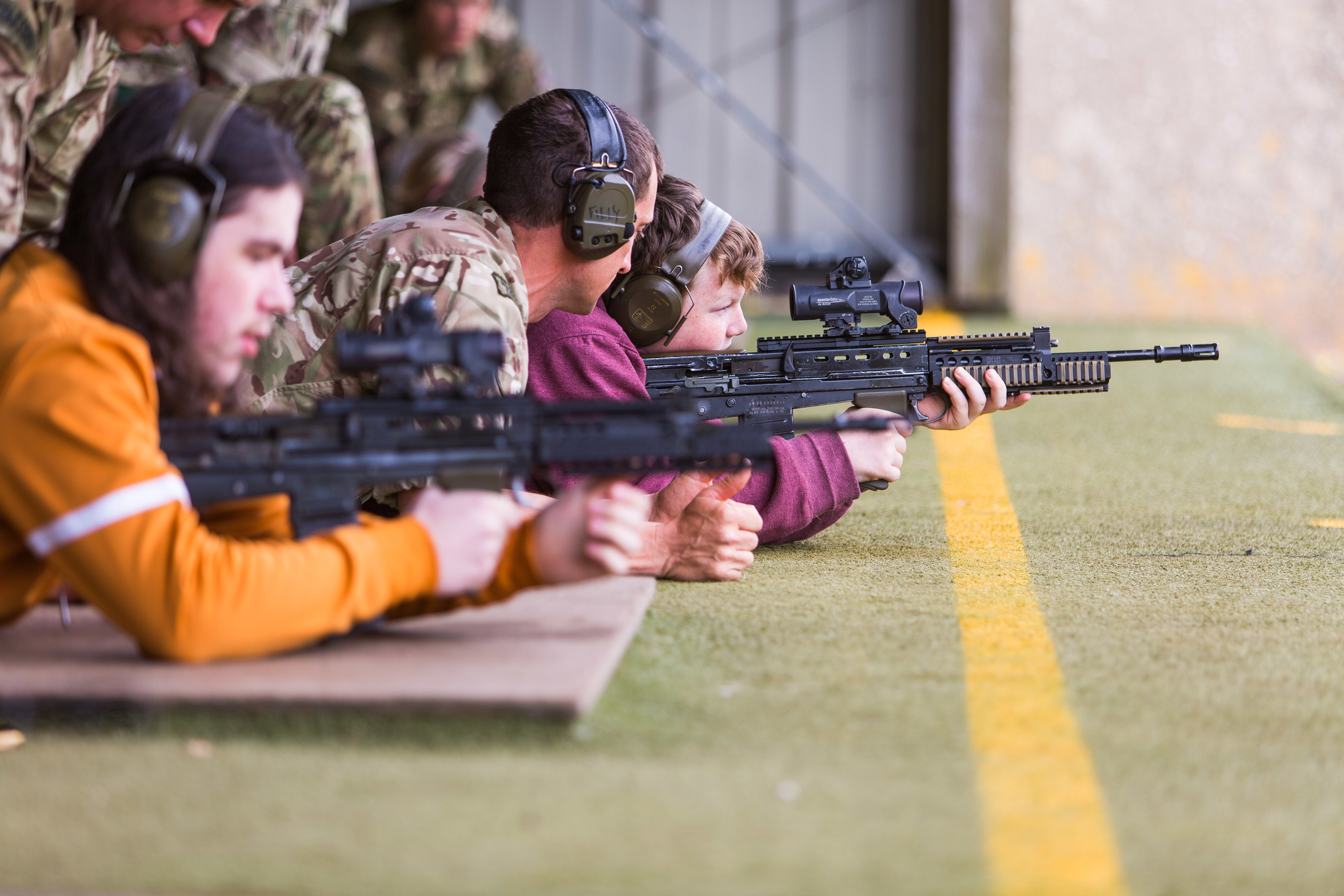 Royal Marines demonstrate to Lochlan Thomson (13) the workings of an SA80 prior to going live on the range.