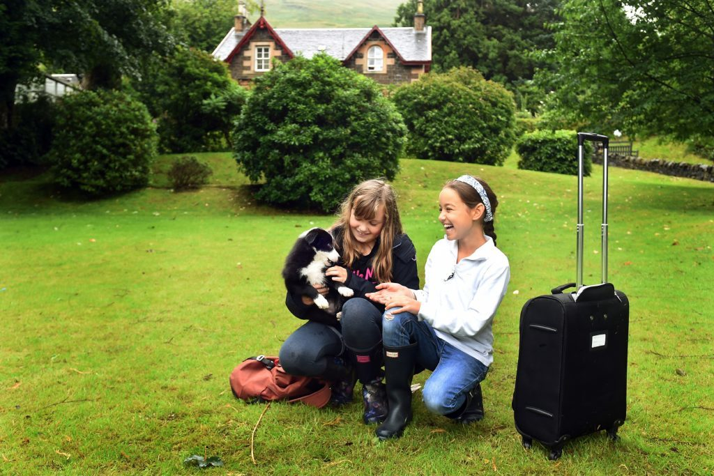 Kids and their puppy having fun outside runner-up Mansefield House.