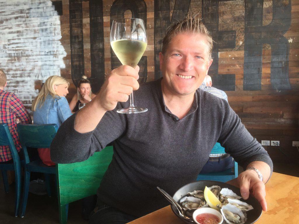 Robin enjoying a glass or two of vino in Western Australia.