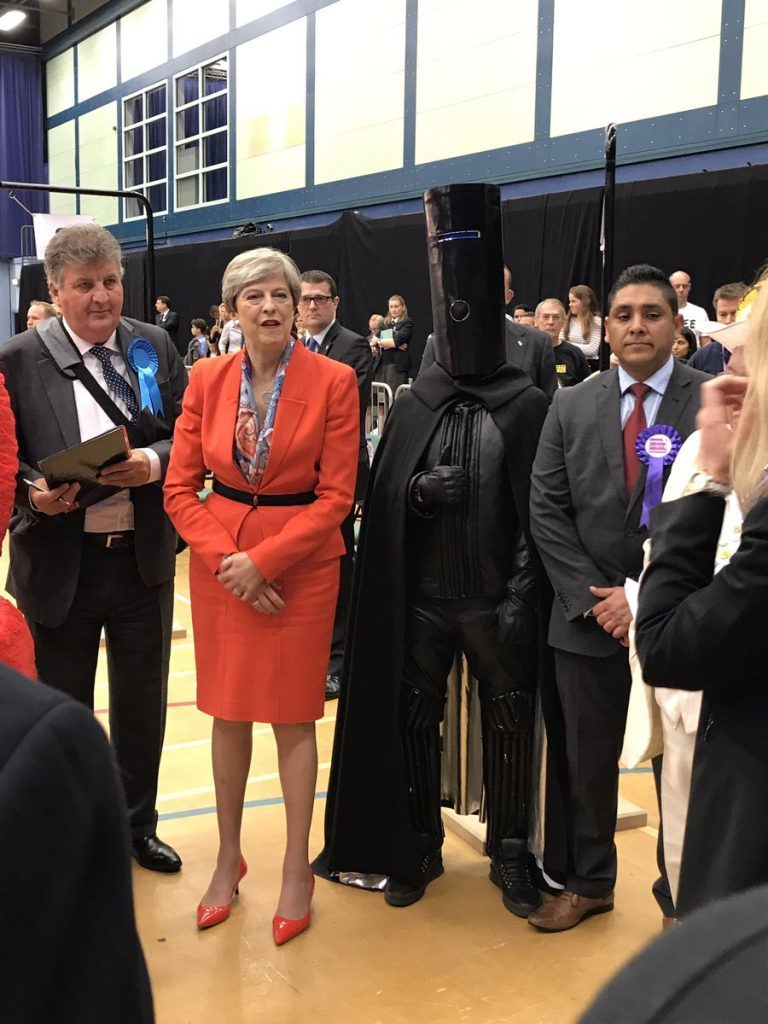 Theresa May next to Lord Buckethead. Credit: @LordBuckethead