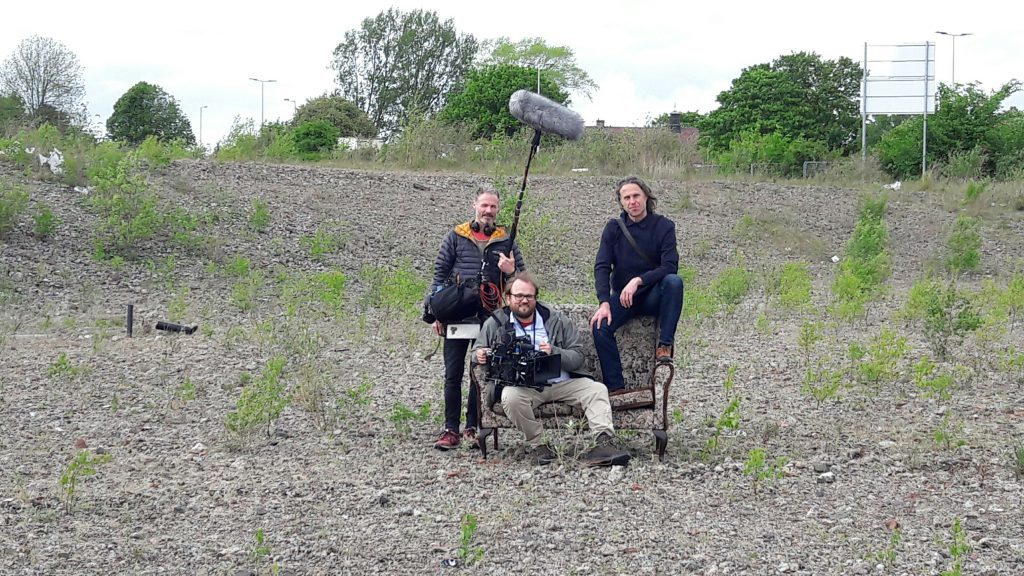 Soundman Cammy Mercer, cameraman Julian Schwanitz and director Martin Smith on the waste ground at Kingsway East
