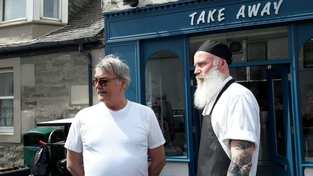 Murray's chip shop owner Angus Murray with actor Dave Dixon who is playing the 'rock n'roll friar'