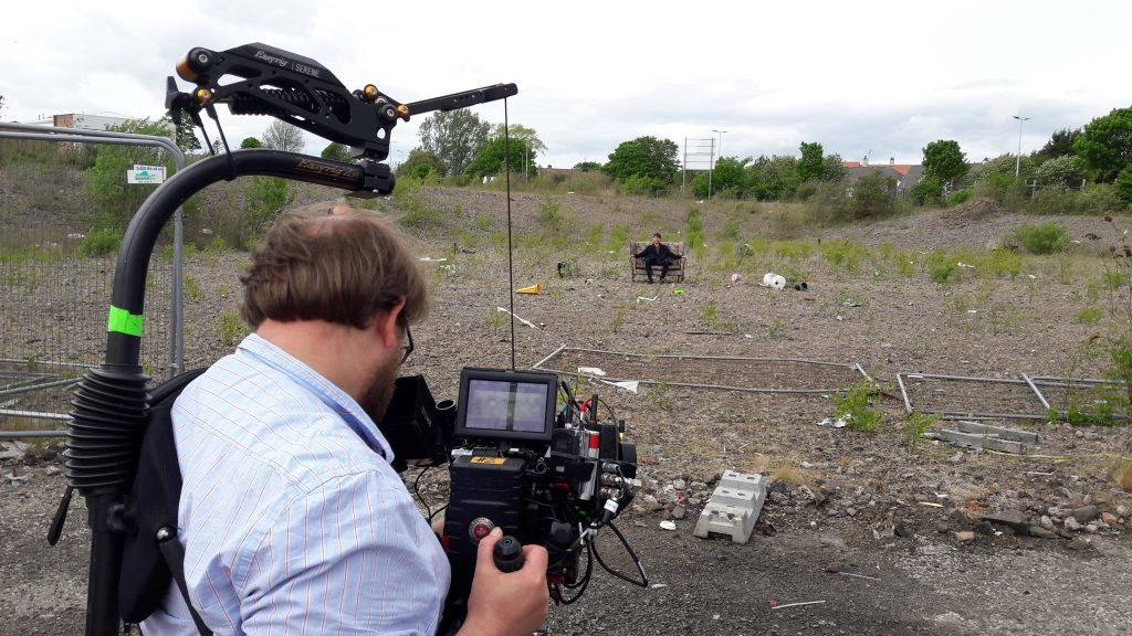 Filming on waste ground at Kingsway East, Dundee
