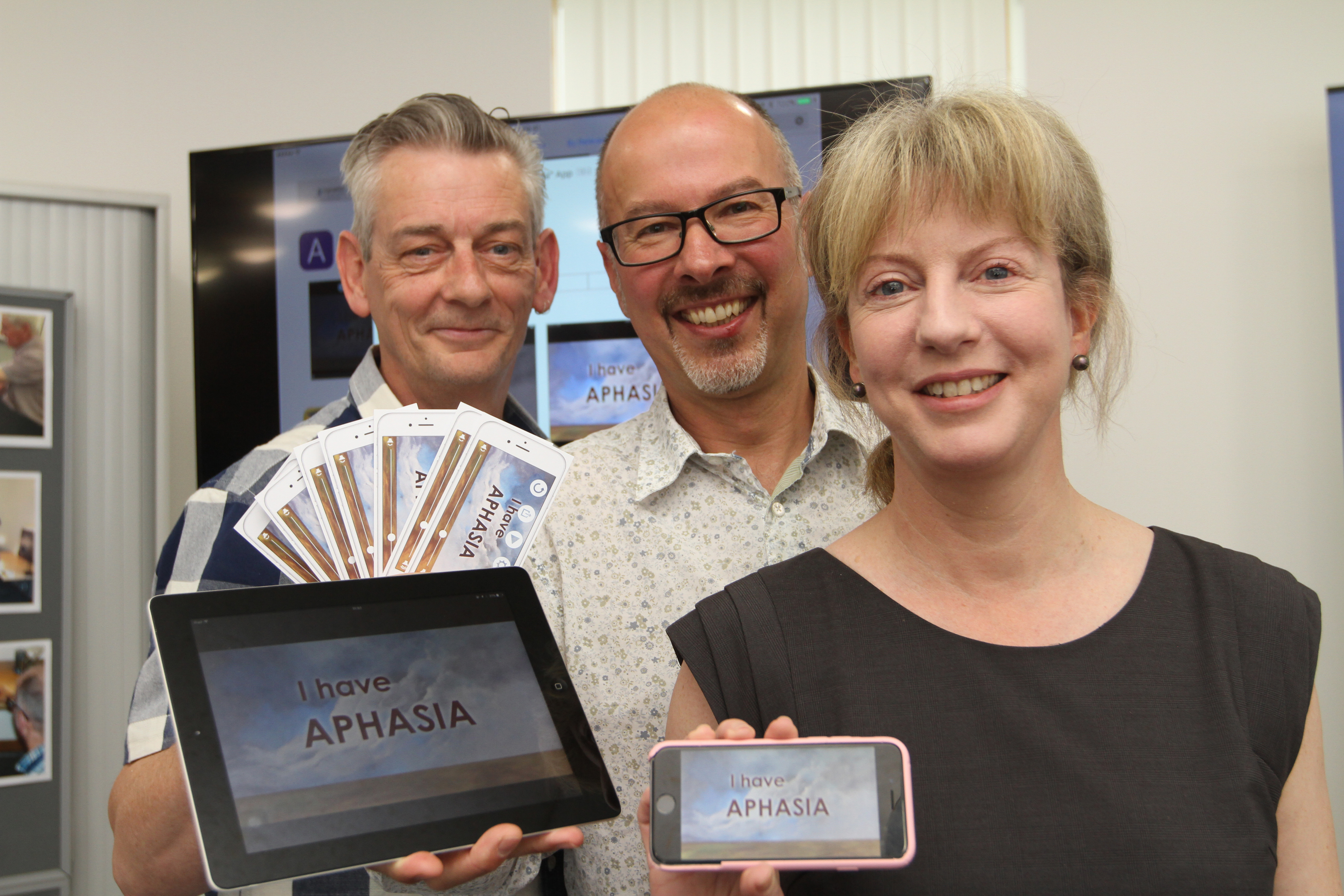 Health secretary Shona Robinson with project coordinator Chris Kelly and Rolf Black, project leader for Aphasia Ipad Group