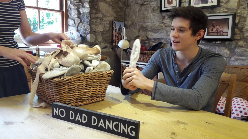 Harris Bell having a bit of fun with some old ballet shoes at home