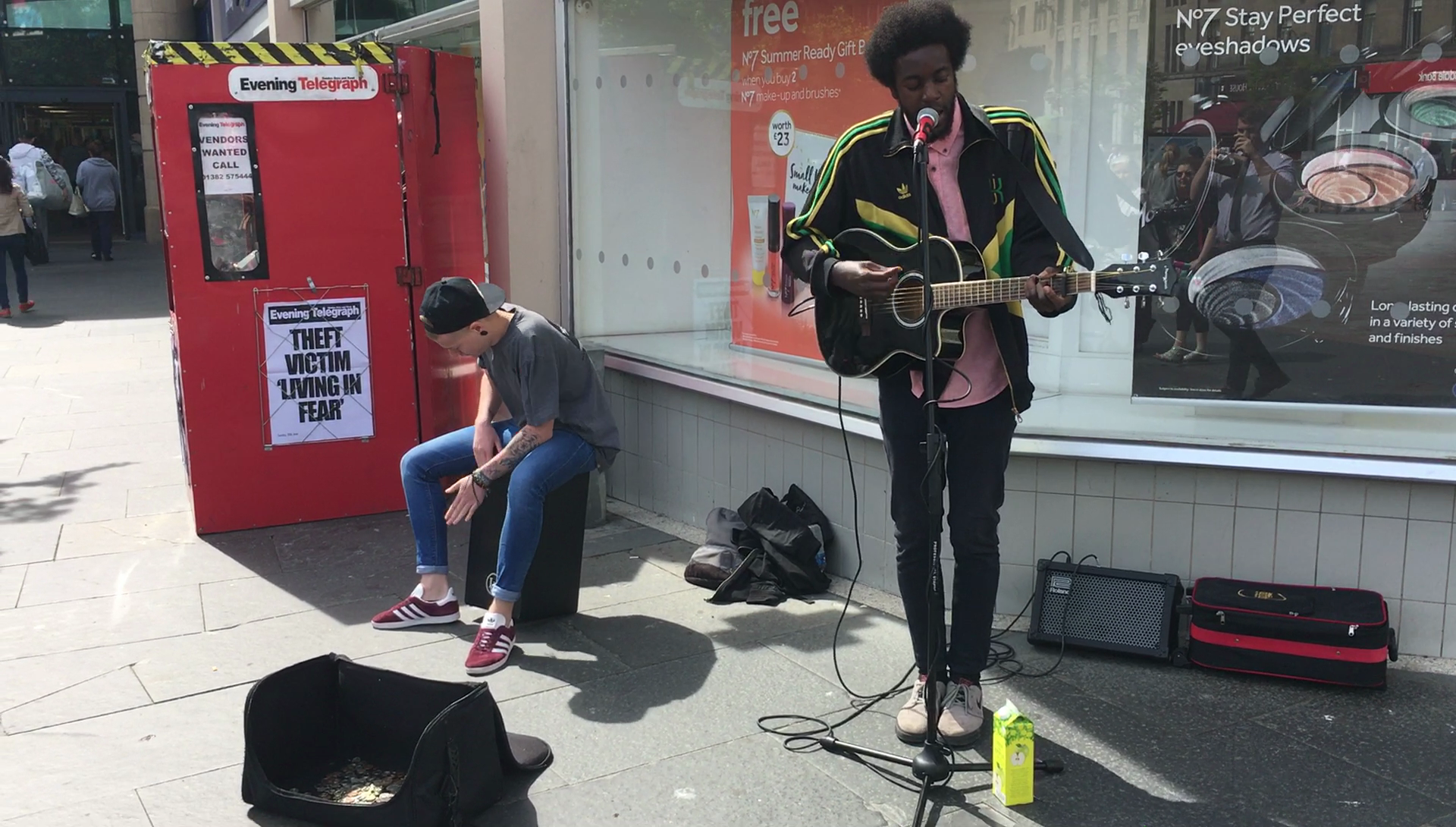 Brandyn Murphy and singer-guitarist James Liandu in Dundee City Centre.