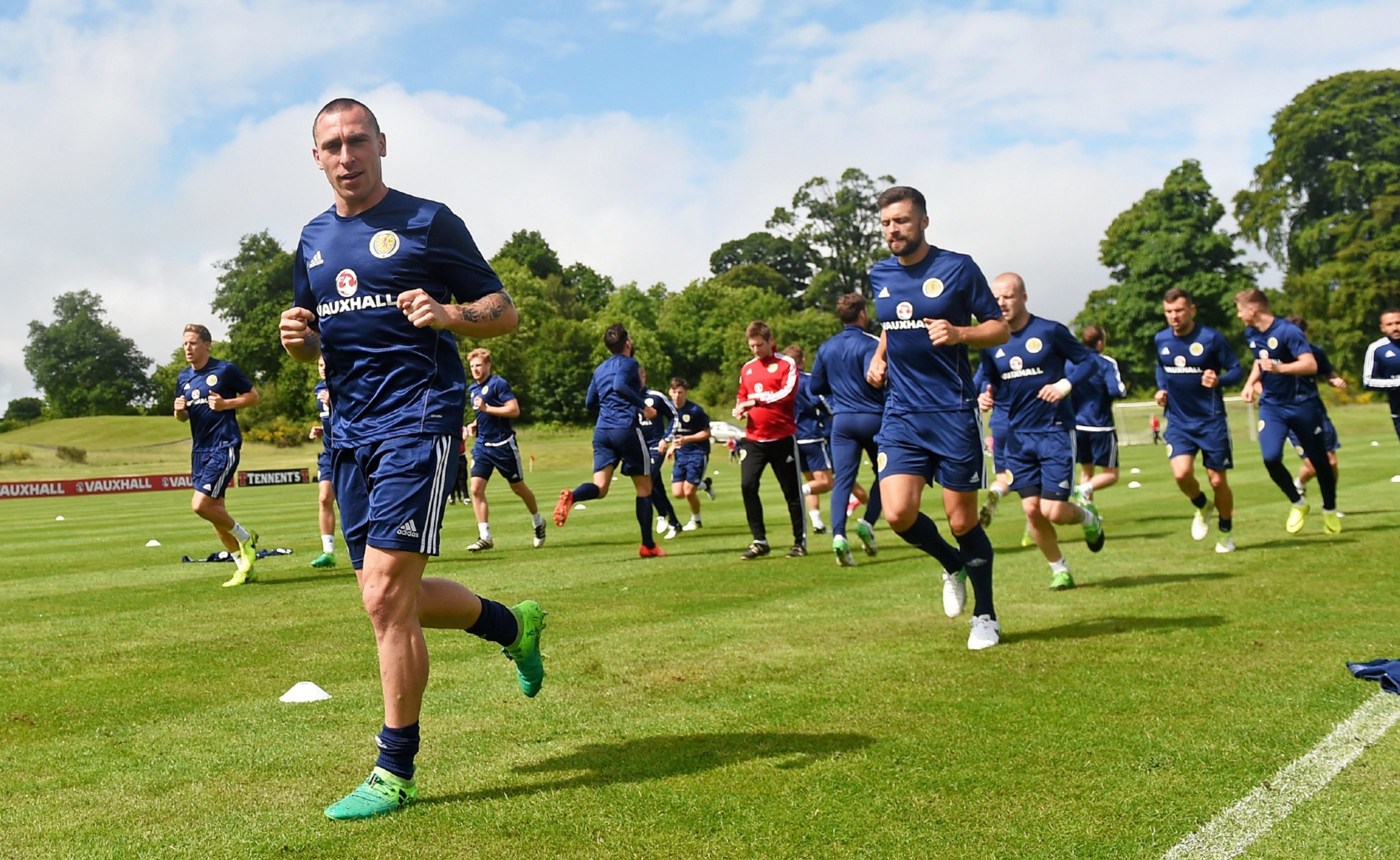 Scott Brown leads the way at training.