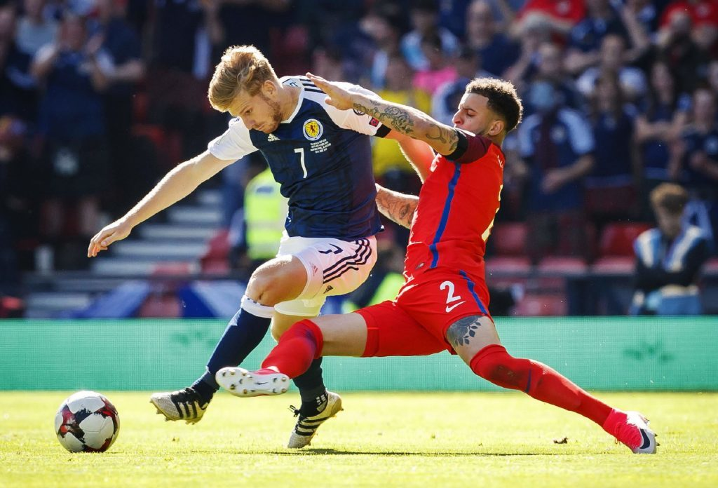 10/06/17 WORLD CUP QUALIFIER SCOTLAND V ENGLAND HAMPDEN PARK - GLASGOW Scotland's Stuart Armstrong and England's Kyle Walker in action