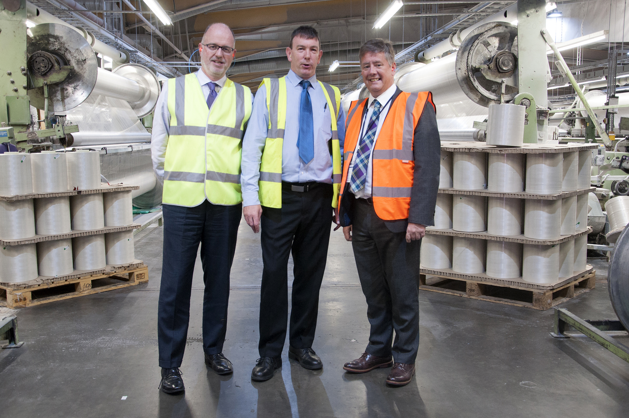 From left — managing director Mark Newstead, general manager of technical textiles John Hughes, and MSP Keith Brown