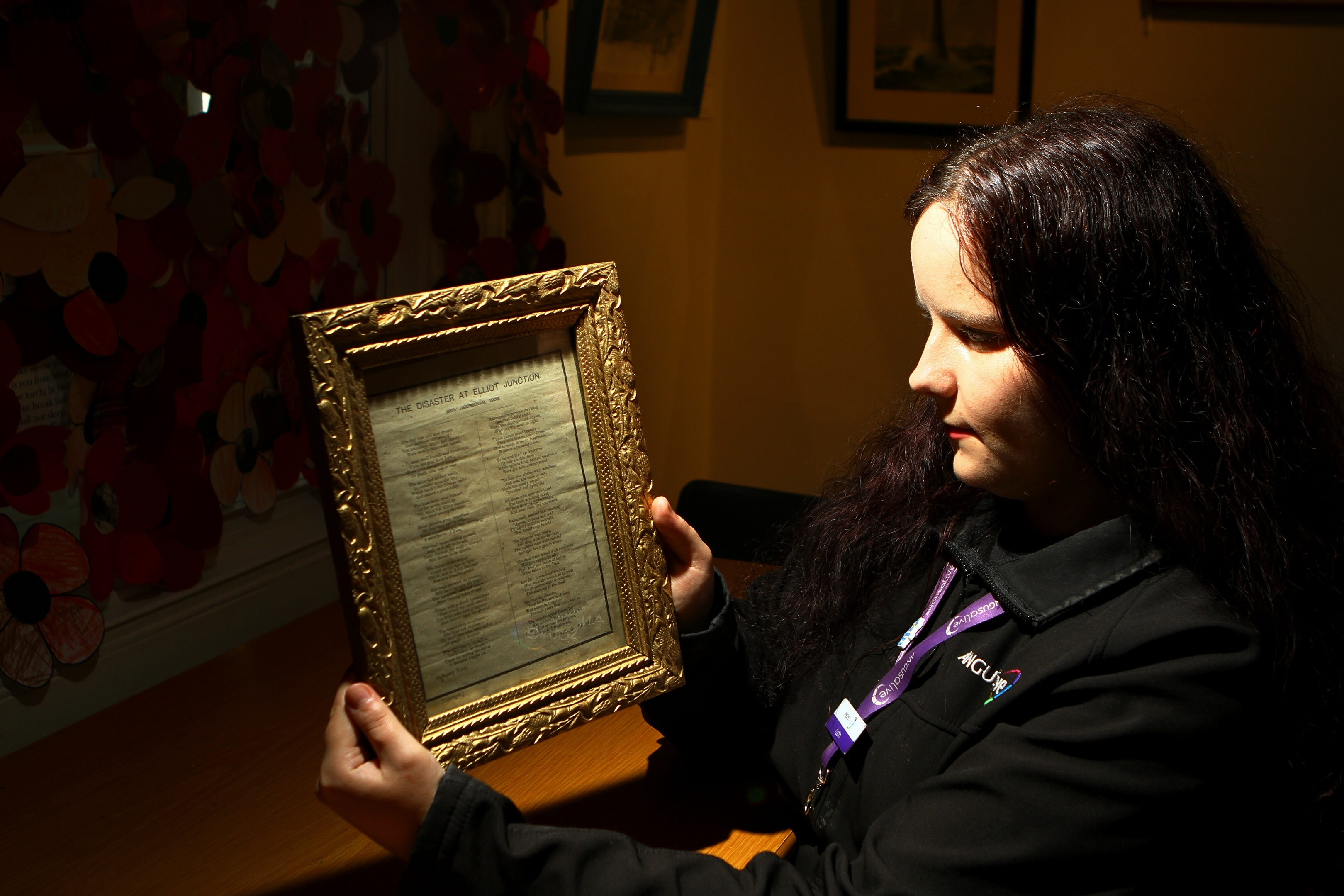 Angus Alive staff member Lucia Wallbank with one of the donated poems at the museum
