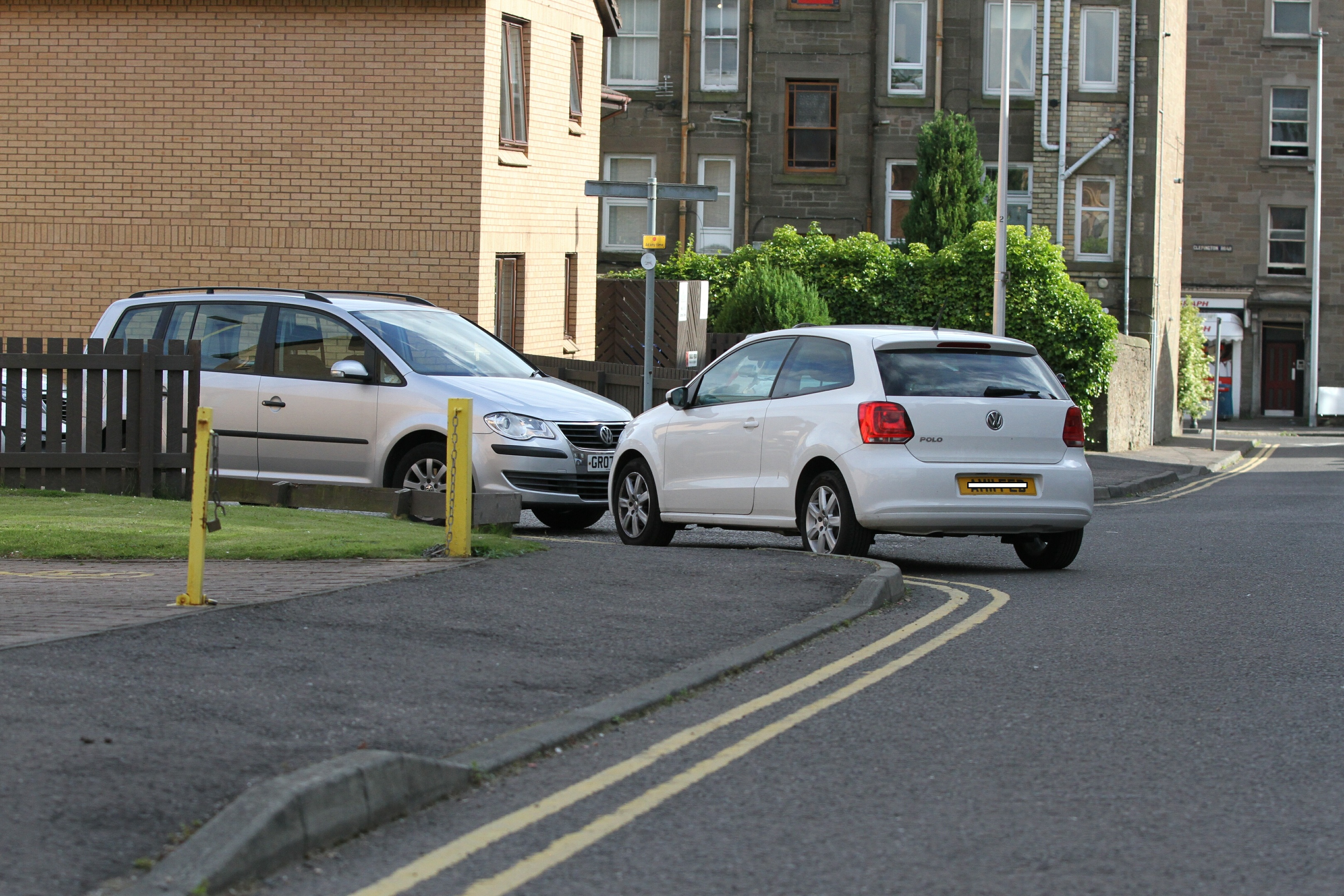 Cars parked on double yellow lines on Cardross Street.