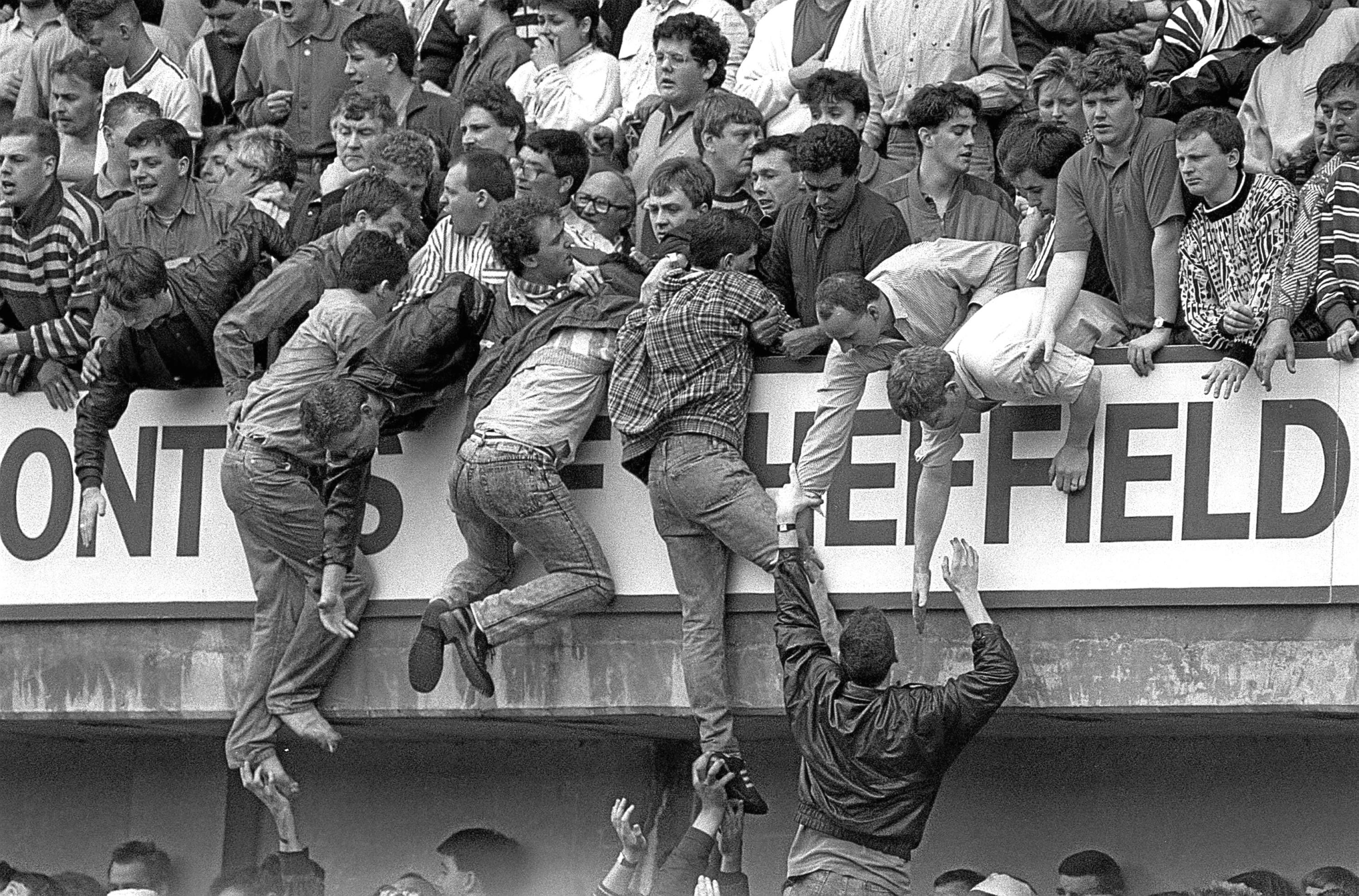 Liverpool fans trying to escape during the Hillsborough disaster.