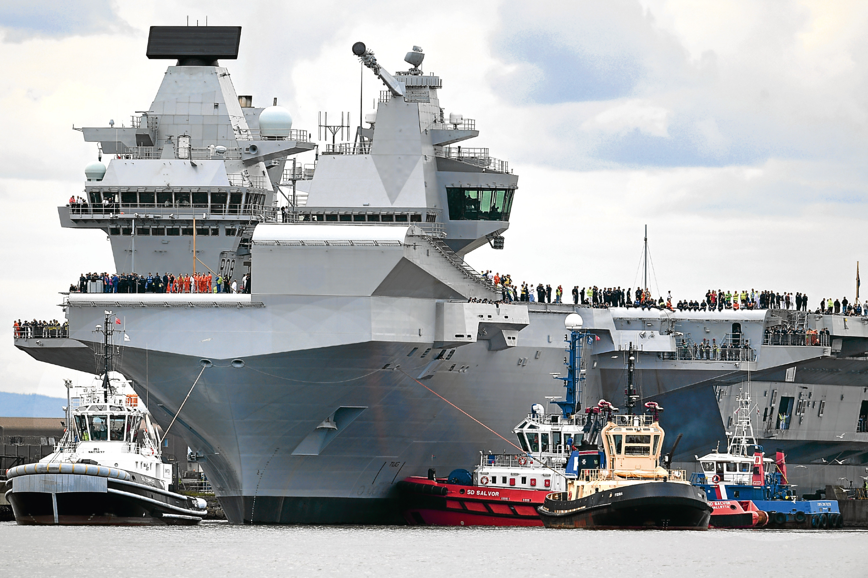 HMS Queen Elizabeth departs Rosyth for sea trials.