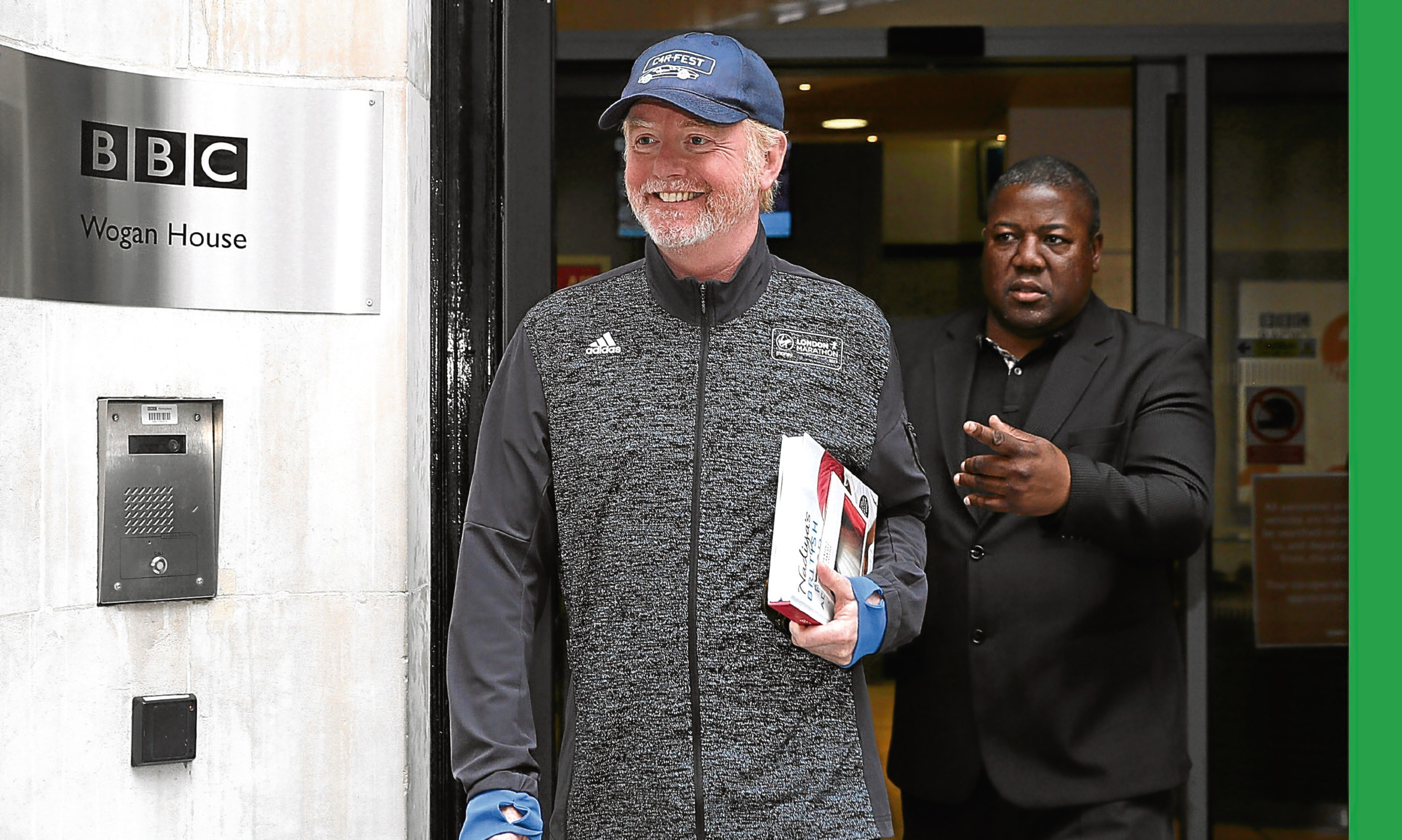 Chris Evans leaves the BBC's Wogan House after his pay was revealed.