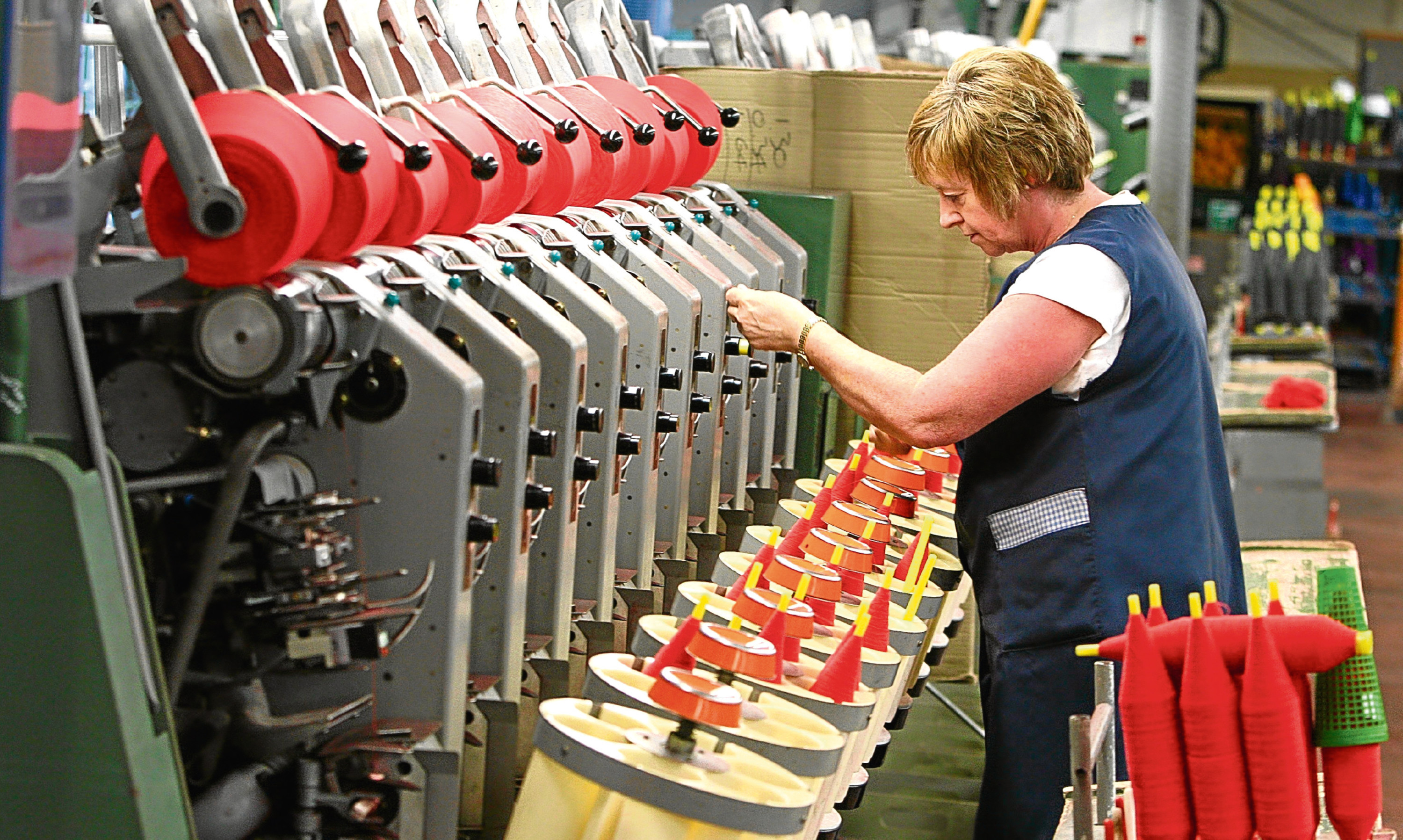 A worker involved in the cashmere yarn manufacturing process at Todd & Duncan's Lochleven Mill in Kinross.