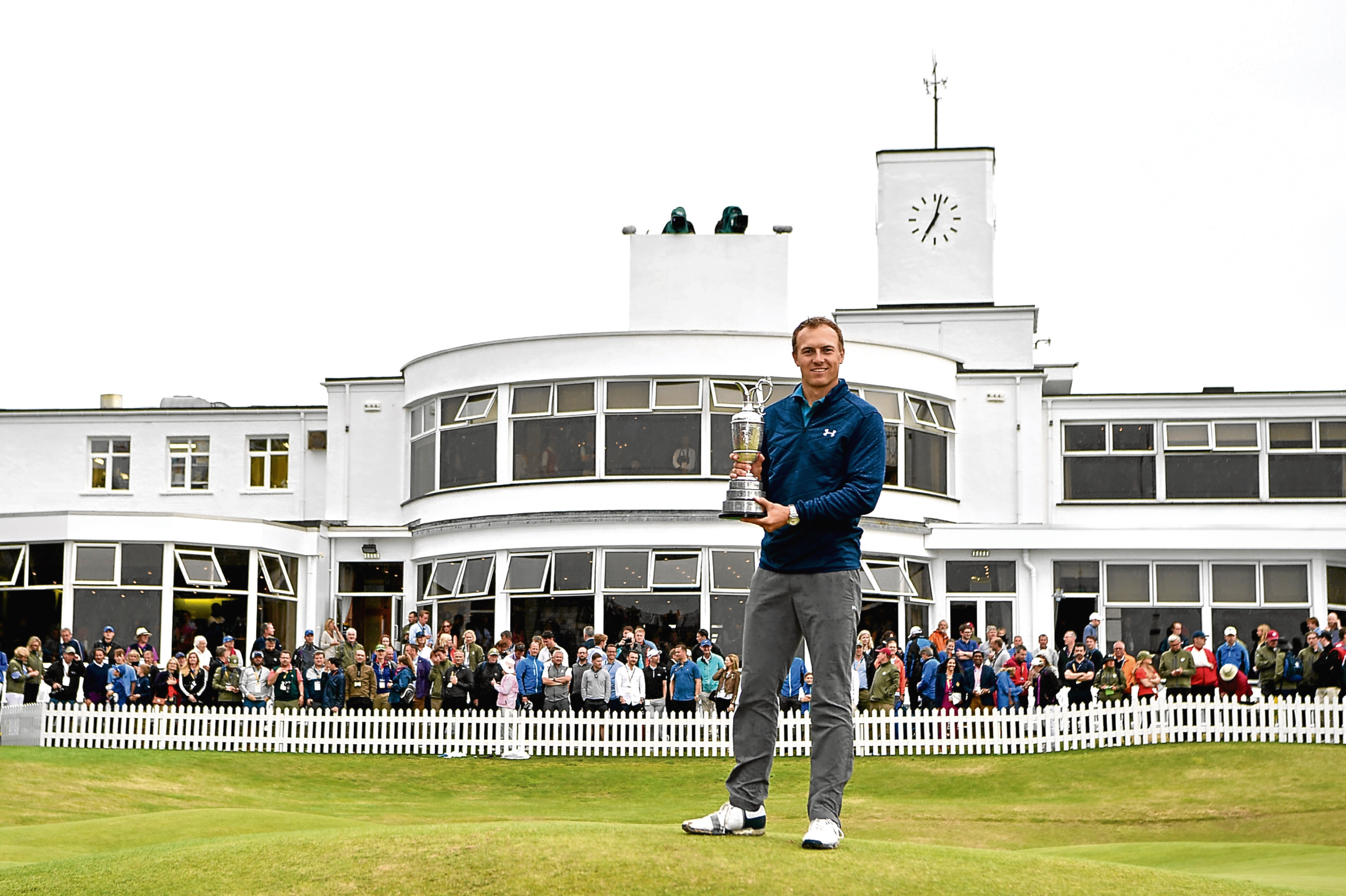 Jordan Spieth with the Claret Jug in front of Royal Birkdale's famous art deco clubhouse.