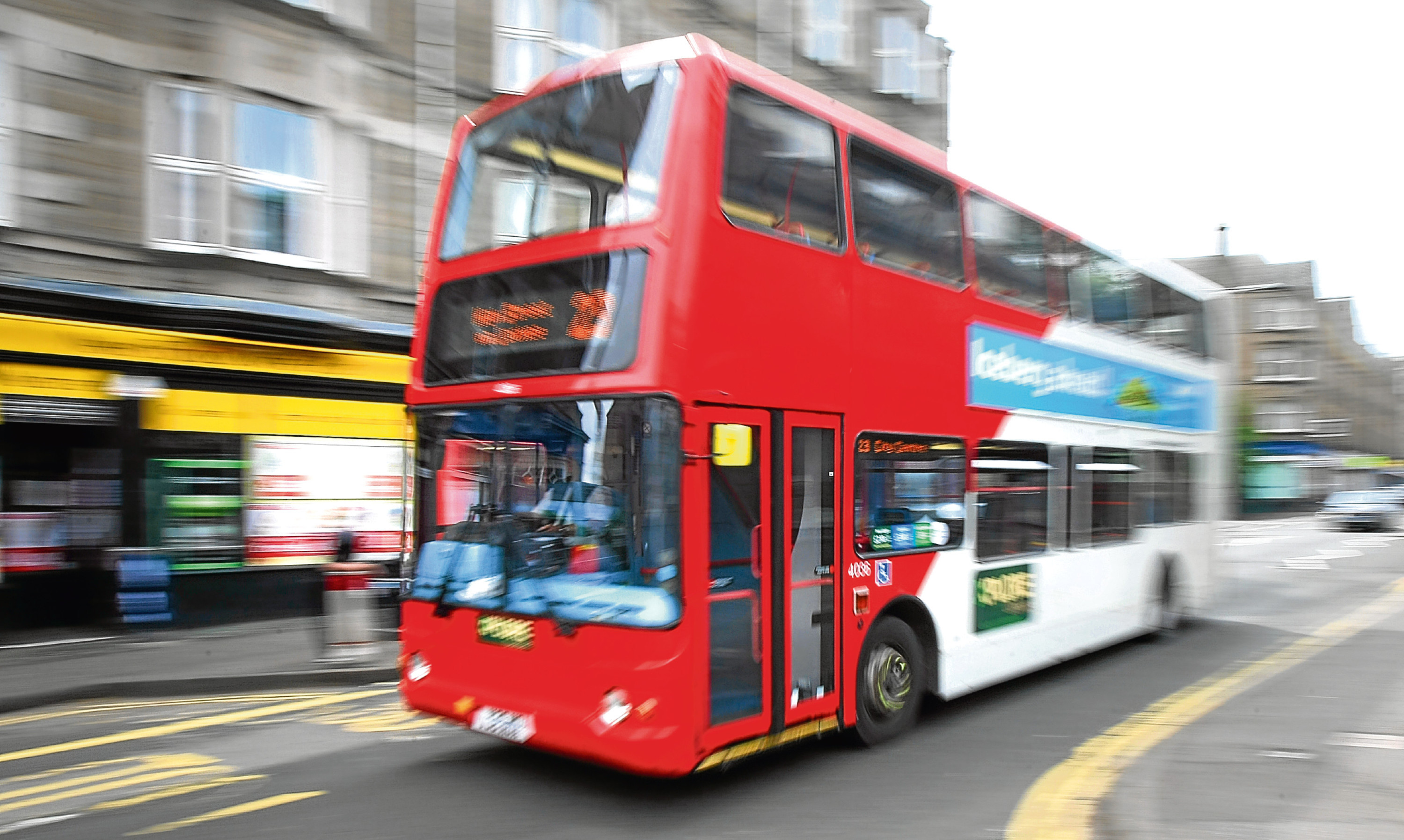 An Xplore Dundee bus navigates the city's Perth Road