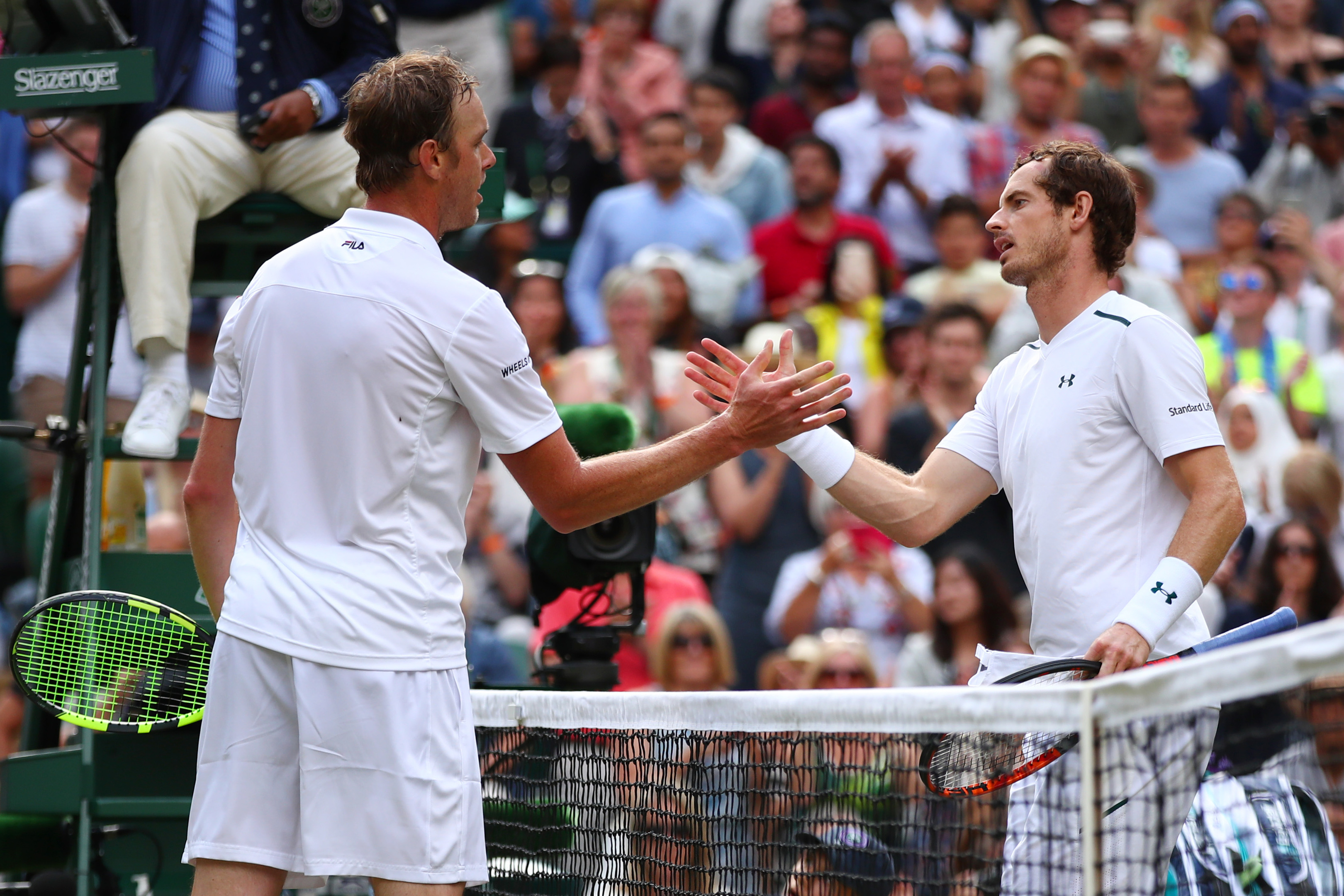 Andy Murray of Great Britain and Sam Querrey of The United States shake hands after the Gentlemen's Singles quarter final match on day nine of  Wimbledon.