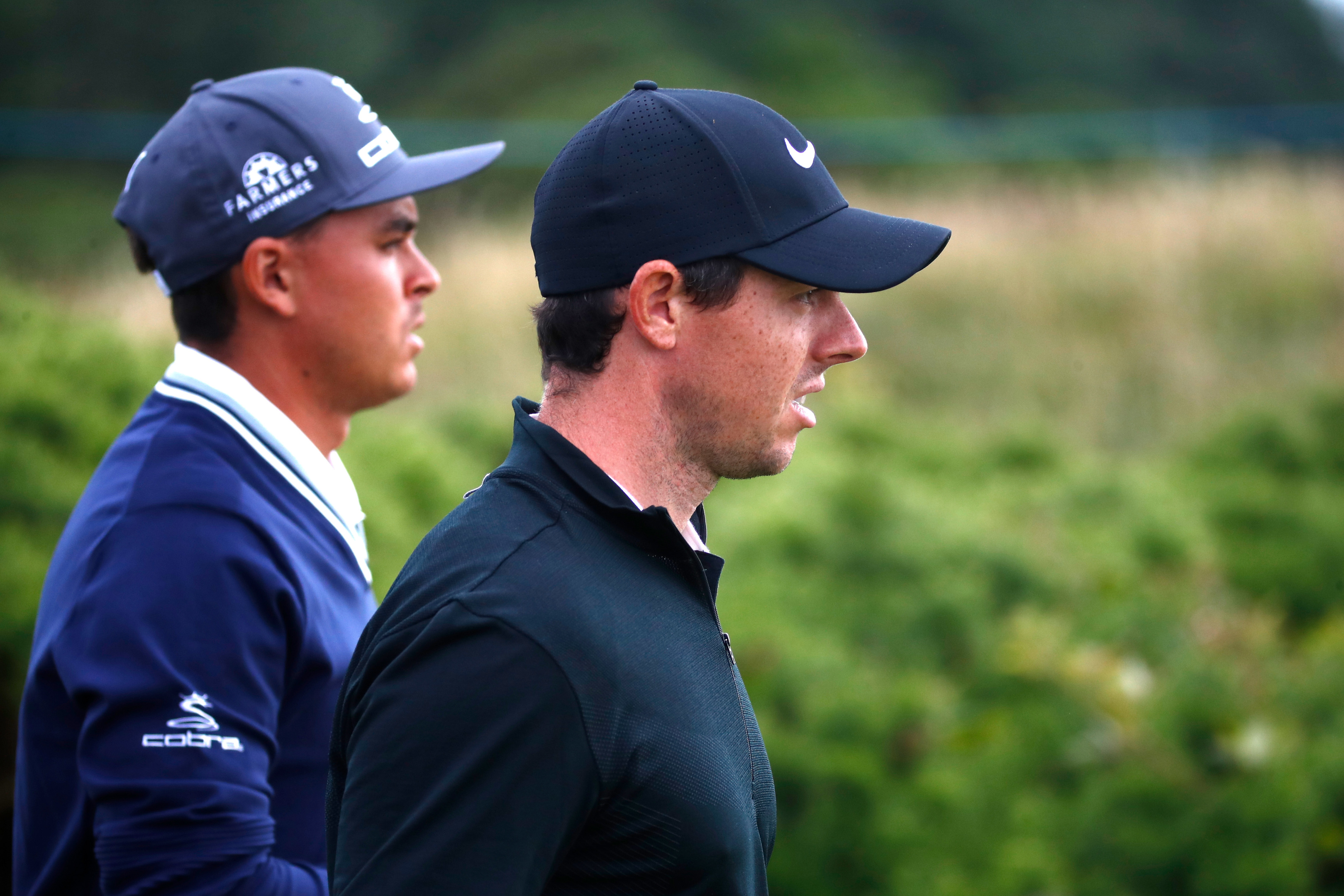 Rickie Fowler (left) prospered as Rory McIlroy struggled on the opening day of the AAM Scottish Open.