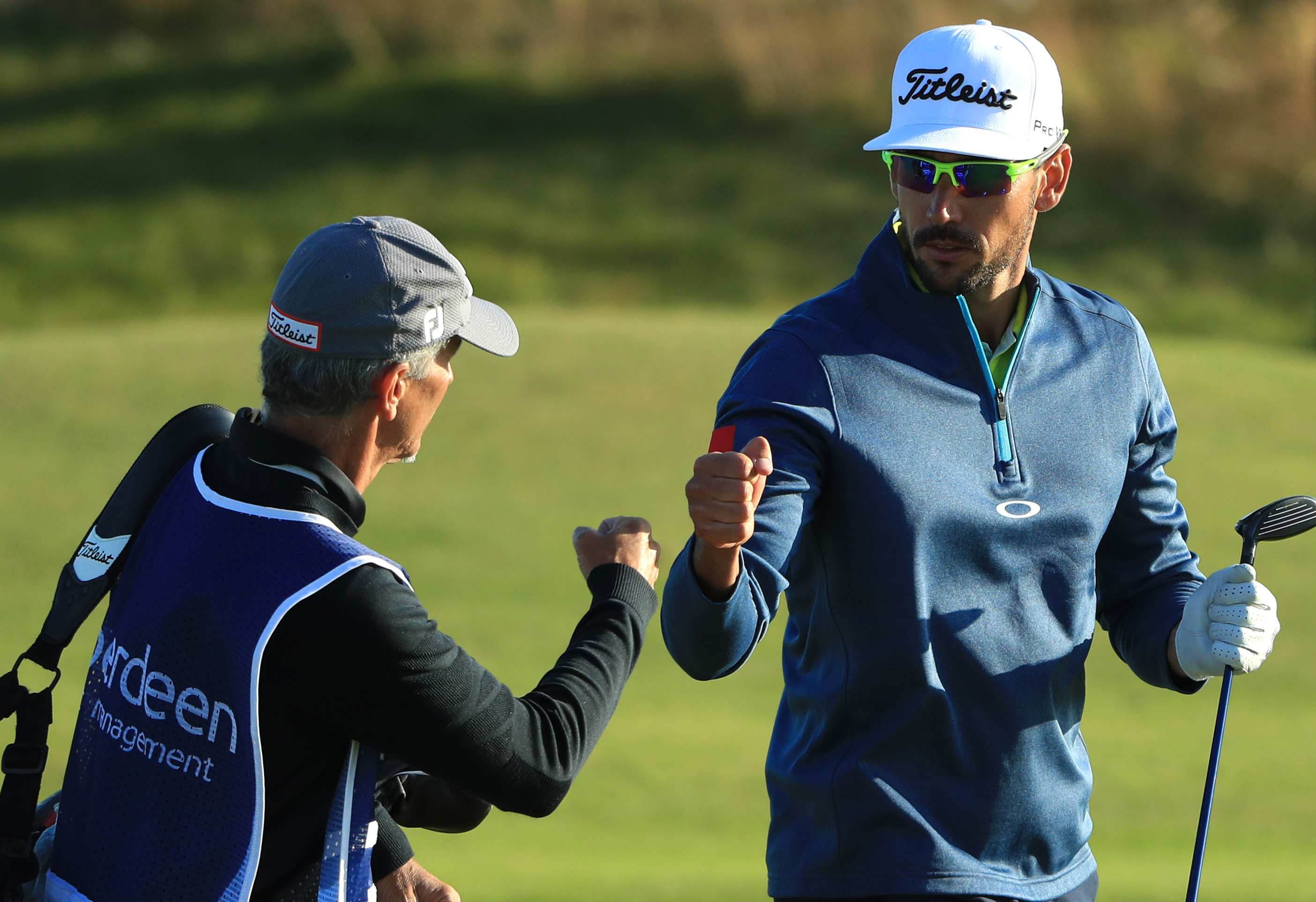 Rafa Cabrera Bello fist bumps caddie Colin Byrne after his second shot on the 1st play off hole of the AAM Scottish Open.