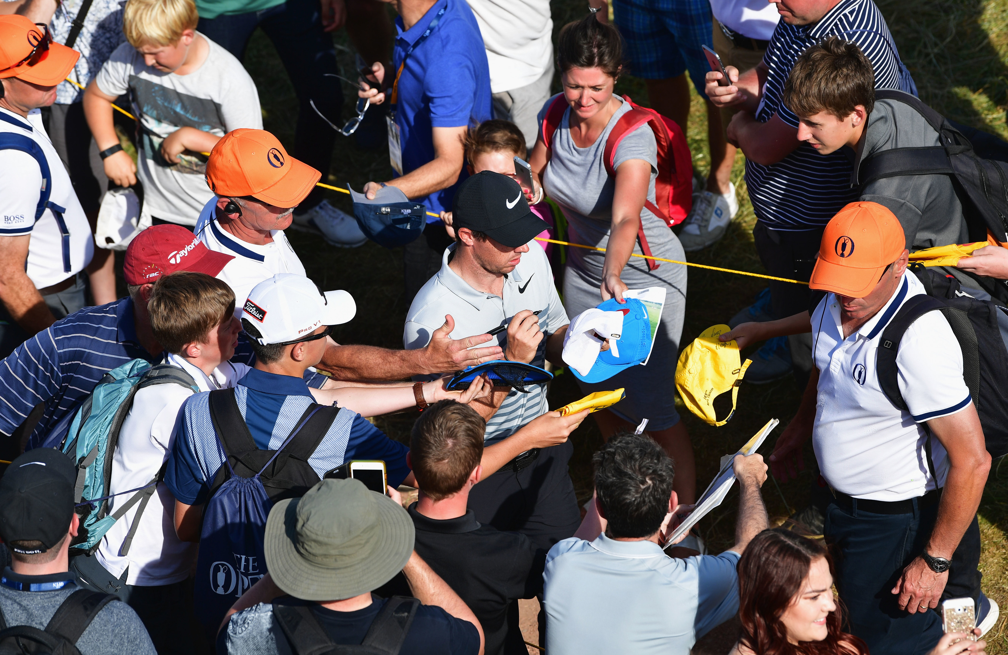 Scrambling for form he may be, but Rory McIlroy is still a huge draw for the autograph hunters.