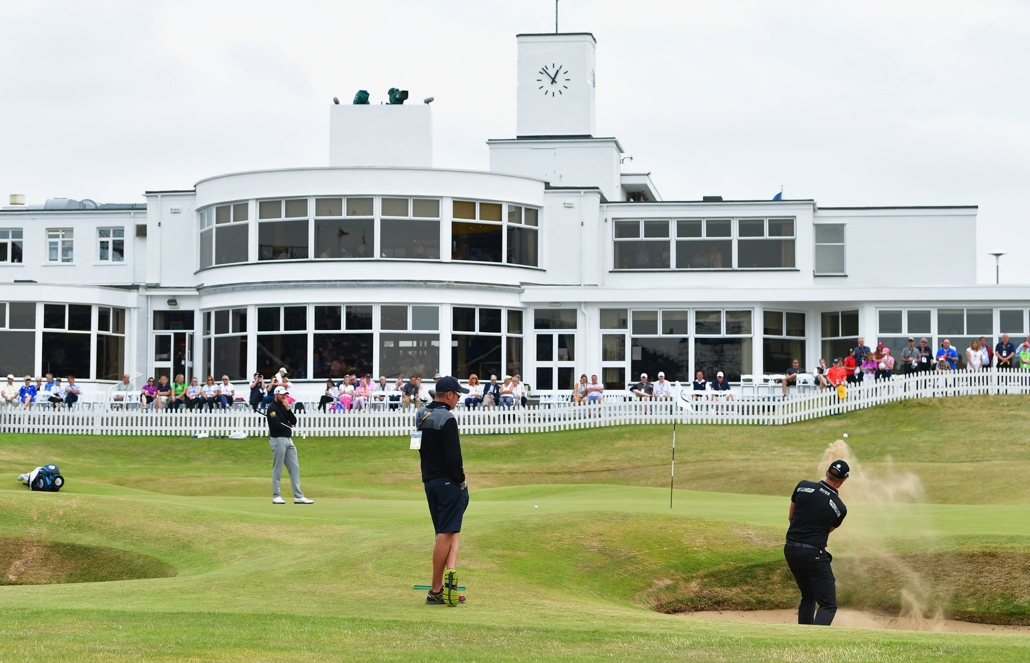 Defending champion Henrik Stenson hits a bunker shot in front of the clubhouse at Royal Birkdale.