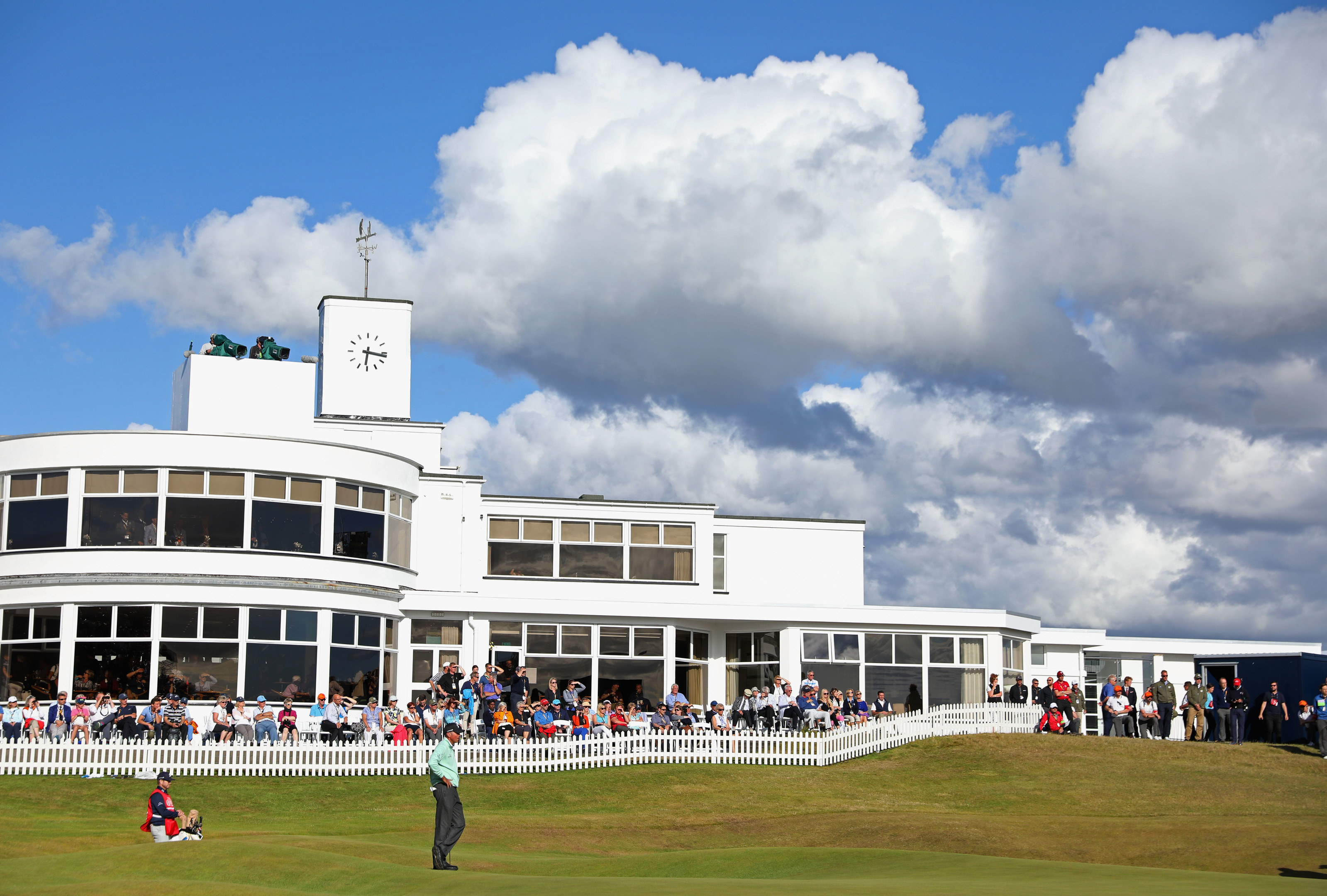 Matt Kuchar gets up and down at the back of the 18th to complete his co-leading 65 at Birkdale.