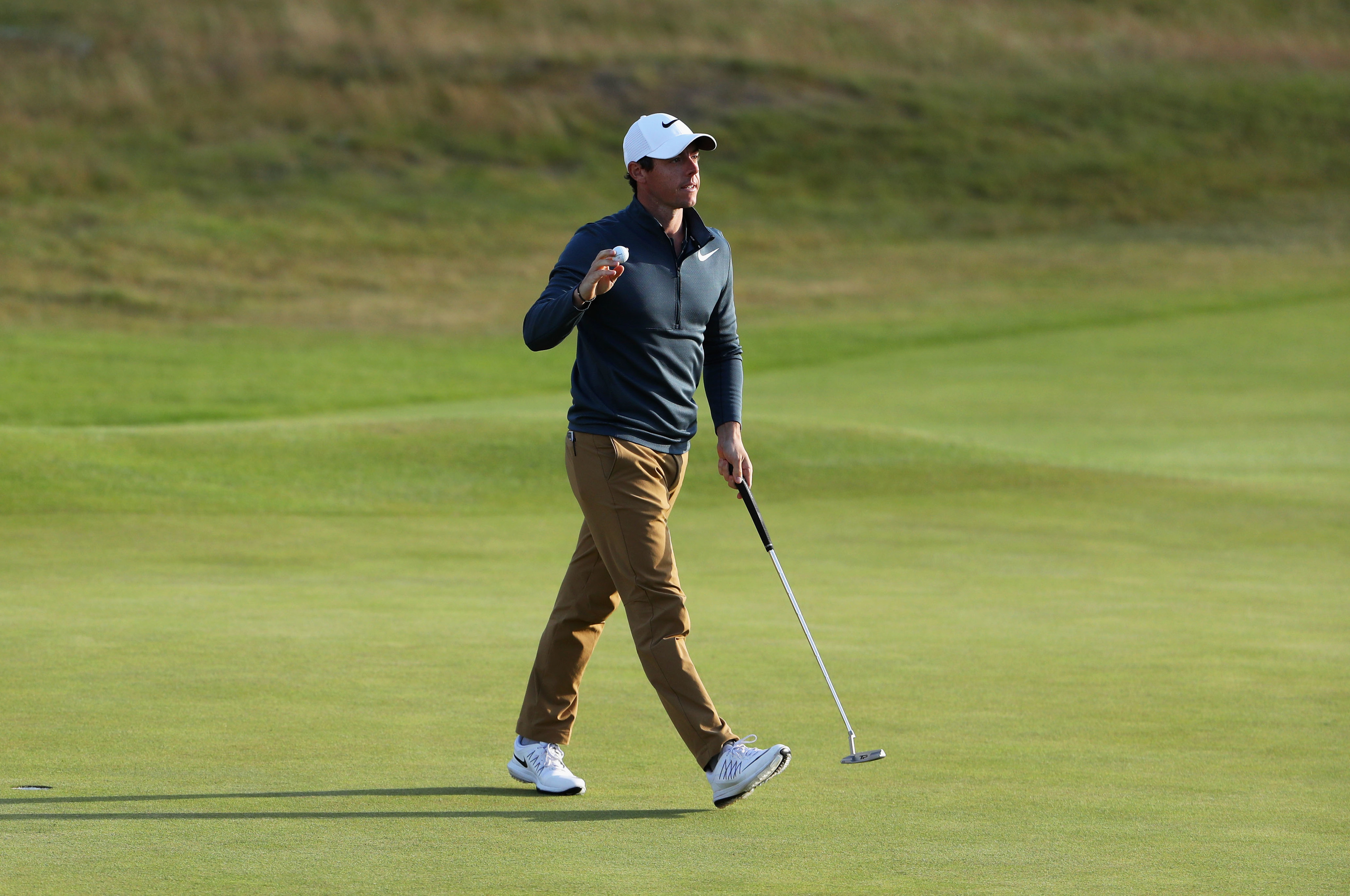 Rory McIlroy reacts to his birdie putt at the 18th at Royal Birkdale.
