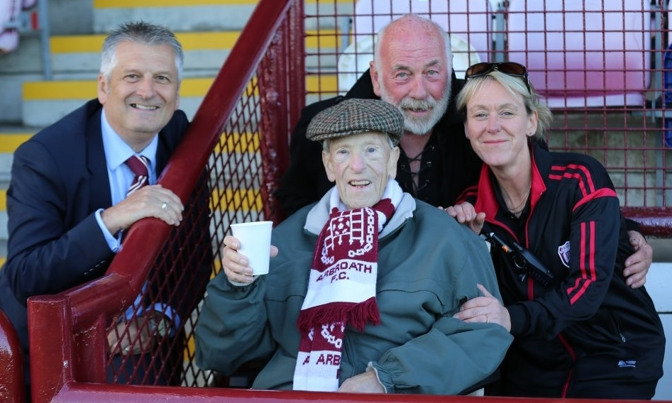 Angus is pictured at his last game at Gayfield in fantastic spirits at the match against Bolton Wanderers with Arbroath chairman Mike Caird, friend Dave Ramsay and facilities and kit manager Louise Walker.