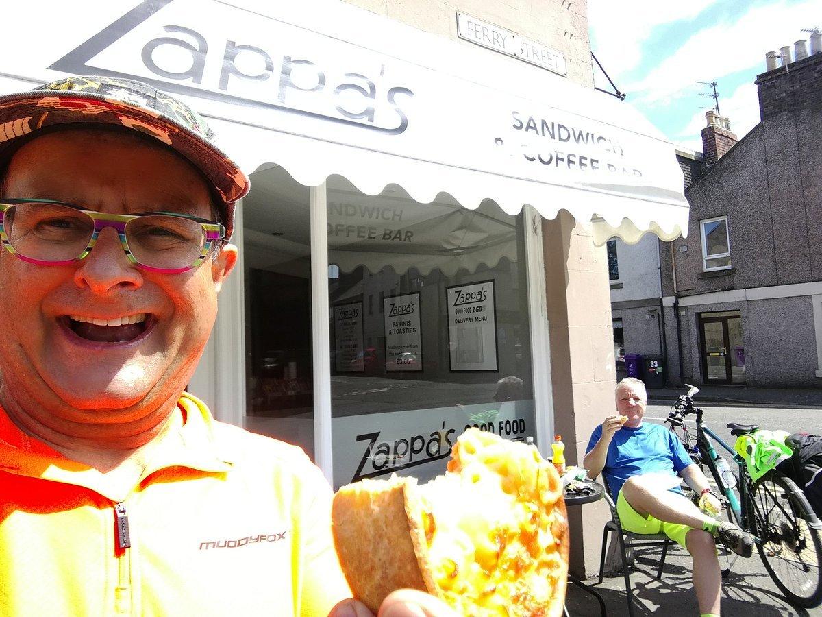 Timmy enjoys a macaroni pie in Montrose alongside Steve.