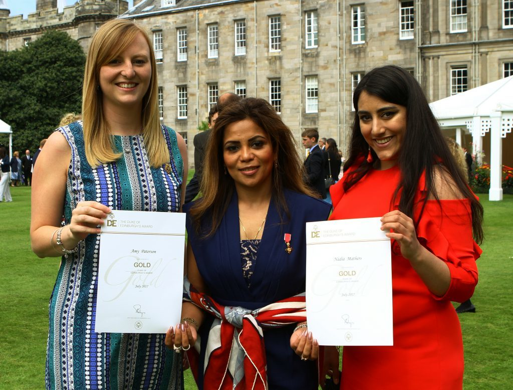 Amy Paterson, left, and Nadia Mathers both from Dundee, with Group Presenter Poonam Gupta OBE, and their certificates.