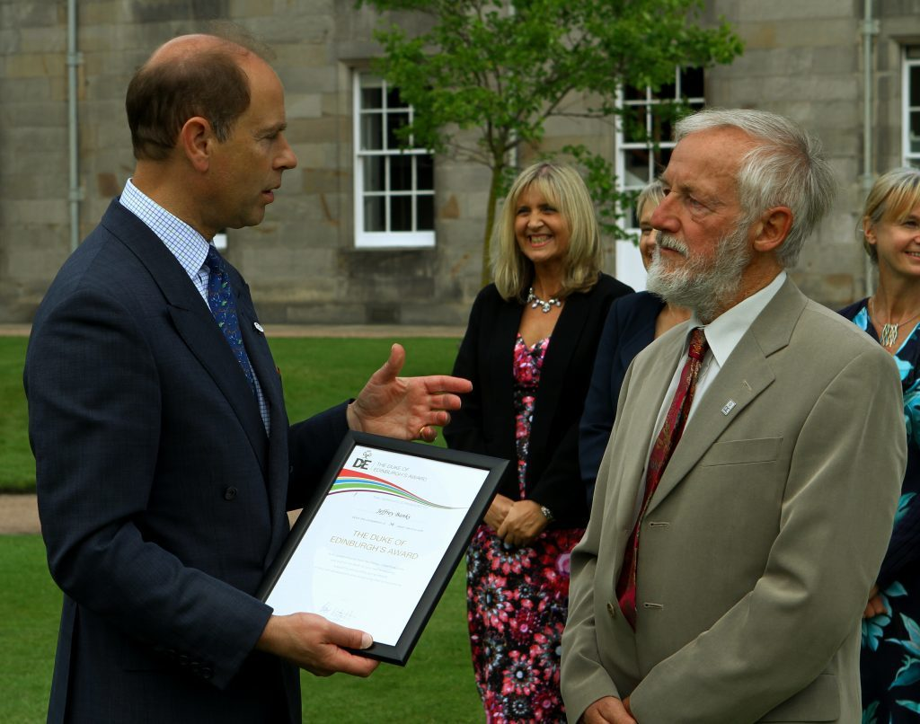 Prince Edward, the Earl of Wessex presenting Jeffrey Banks, from Perth with his certificate on retirement, at the Palace of Holyroodhouse in Edinburgh today.