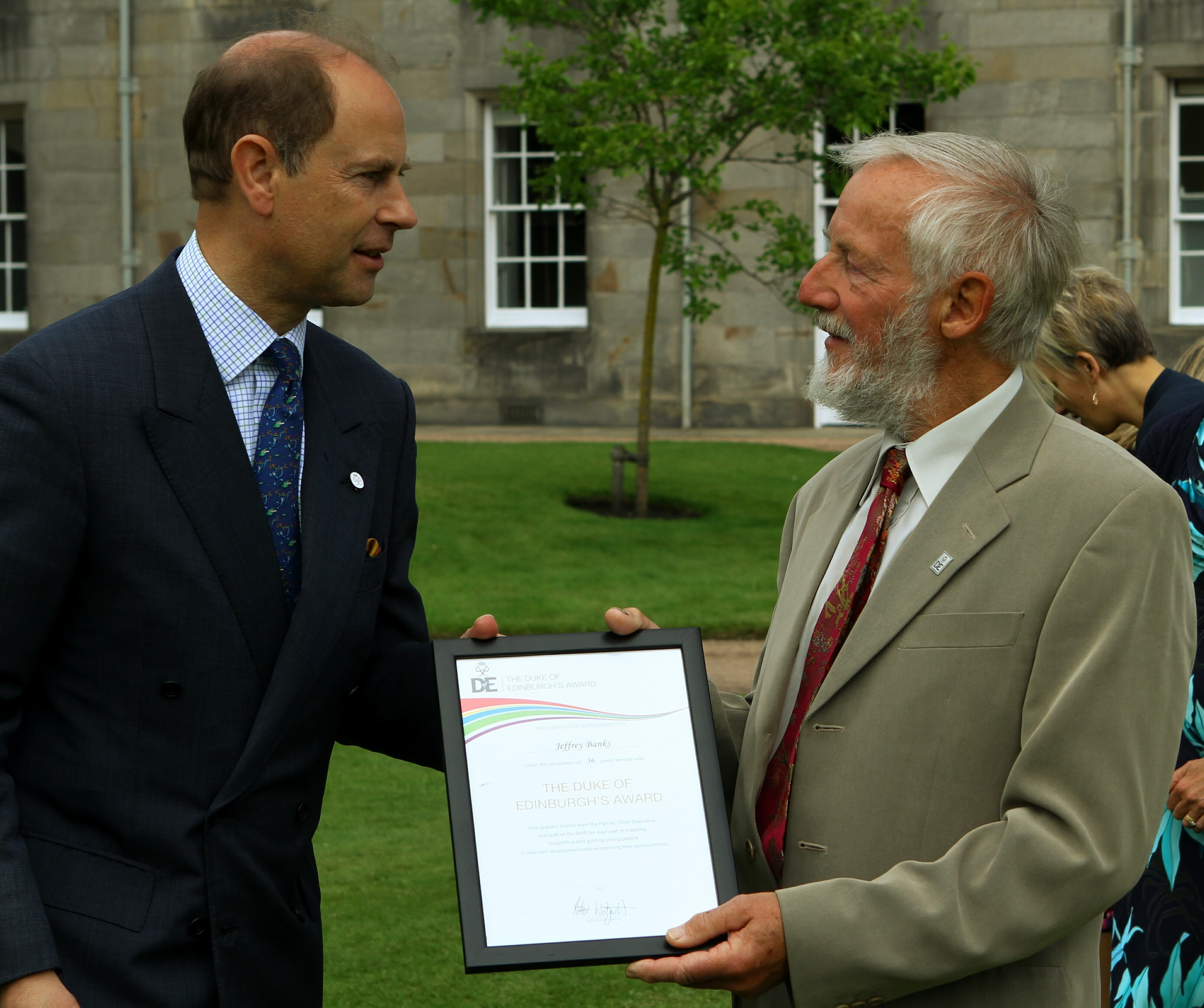 Prince Edward, the Earl of Wessex, presenting Jeffrey Banks, from Perth with his certificate on retirement.